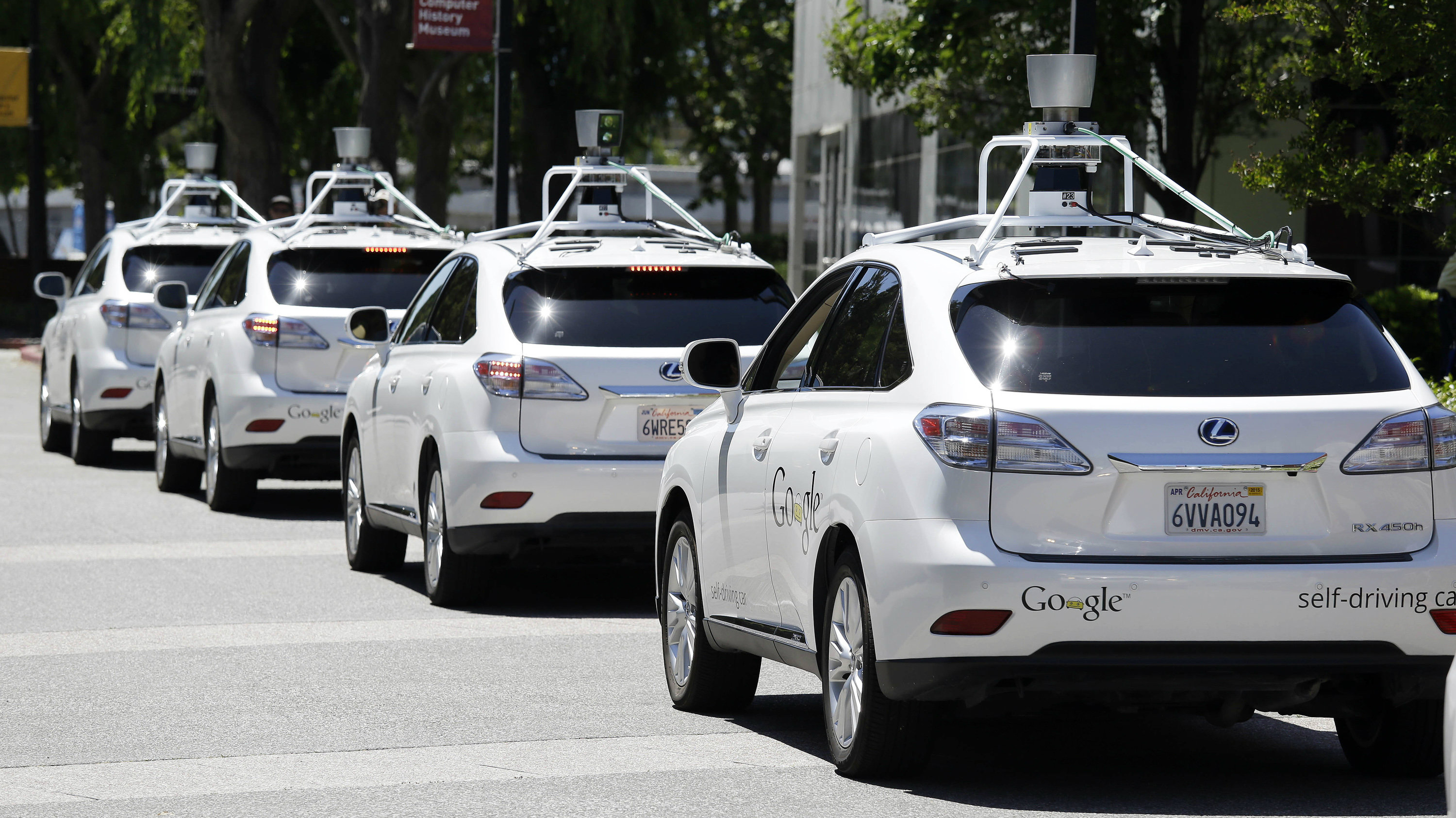 """FILE - This May 13, 2014, file photo shows a row of Google self-driving Lexus cars at a Google event outside the Computer History Museum in Mountain View, Calif. California regulators release safety reports filed by 11 companies that have been testing self-driving car prototypes on public roads on Wednesday, Feb. 1, 2017. The papers report the number of times in 2016 that human backup drivers took control from the cars' self-driving software, though companies argue such """"disengagements"""" don't always reflect something going wrong. (AP Photo/Eric Risberg, File)"""