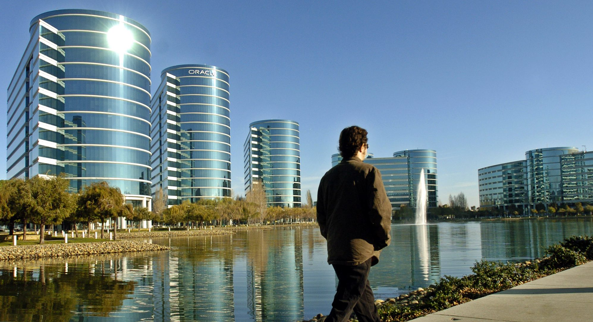 A man walks past the Oracle office in Redwood Shores, Calif., Monday, Dec. 13, 2004.