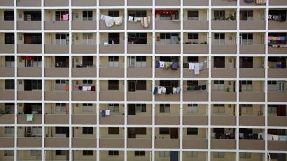 Clothes are hung for drying outside public housing estate flats built by the HDB at a residential area in Singapore