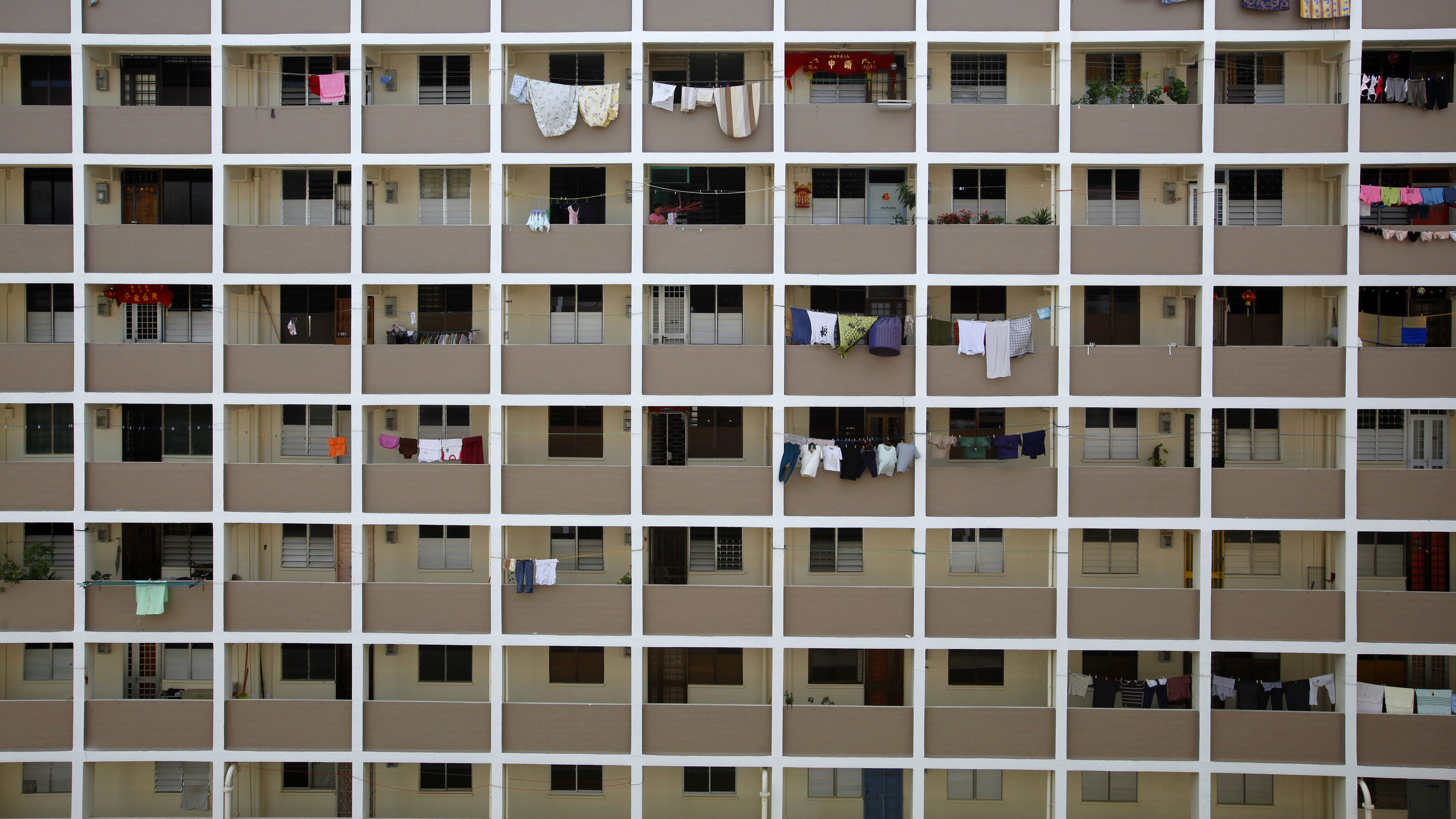Clothes are hung for drying outside public housing estate flats built by the Housing and Development Board (HDB) at a residential area in Singapore January 6, 2010. Prices of HDB resale flats rose 3.8 per cent in the fourth quarter of 2009 to a record high, according to local media. Around 85 per cent of Singaporeans live in HDB flats.