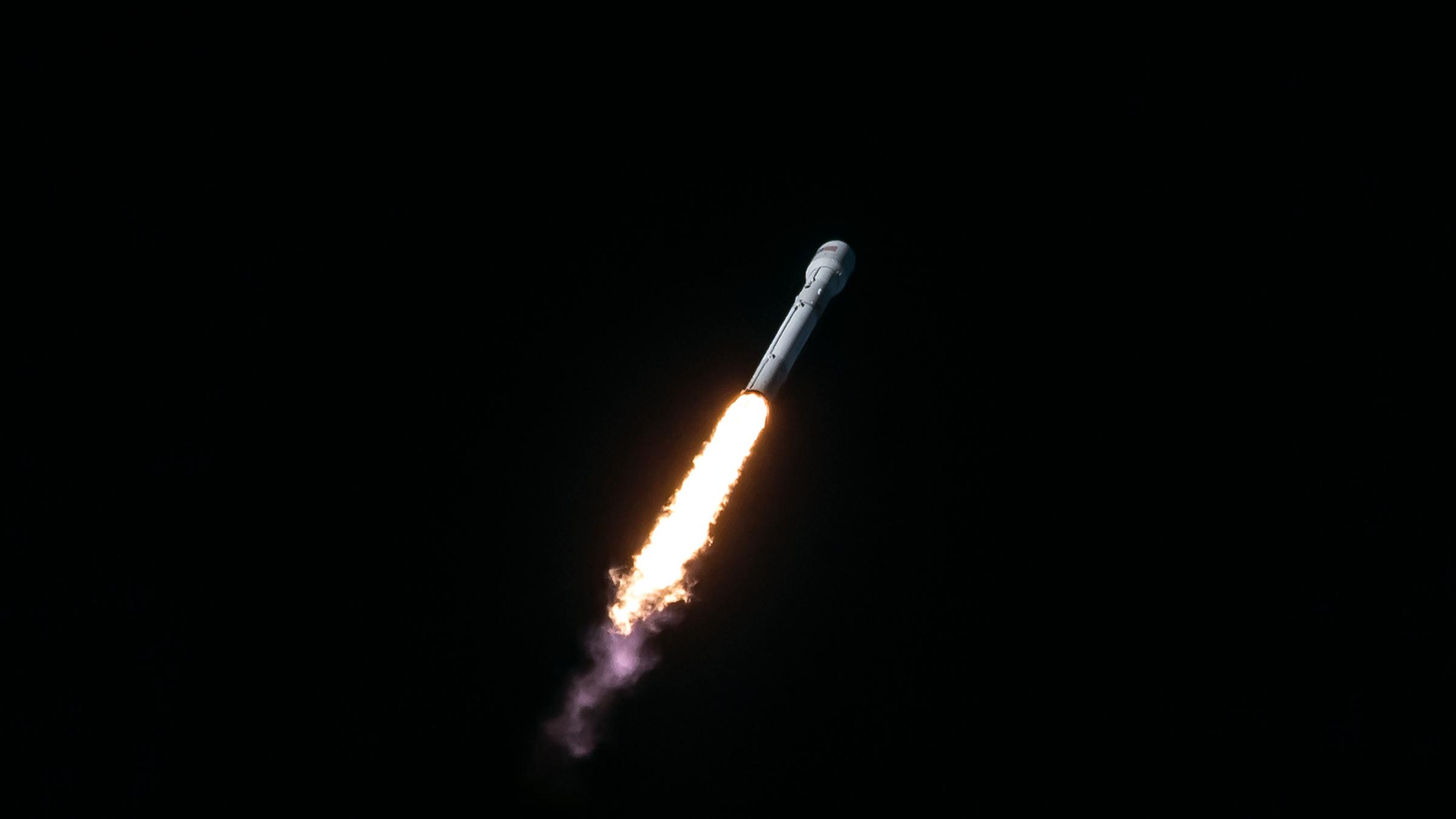 A Falcon 9 rocket carries an Intelsat satellite into orbit on July 5.