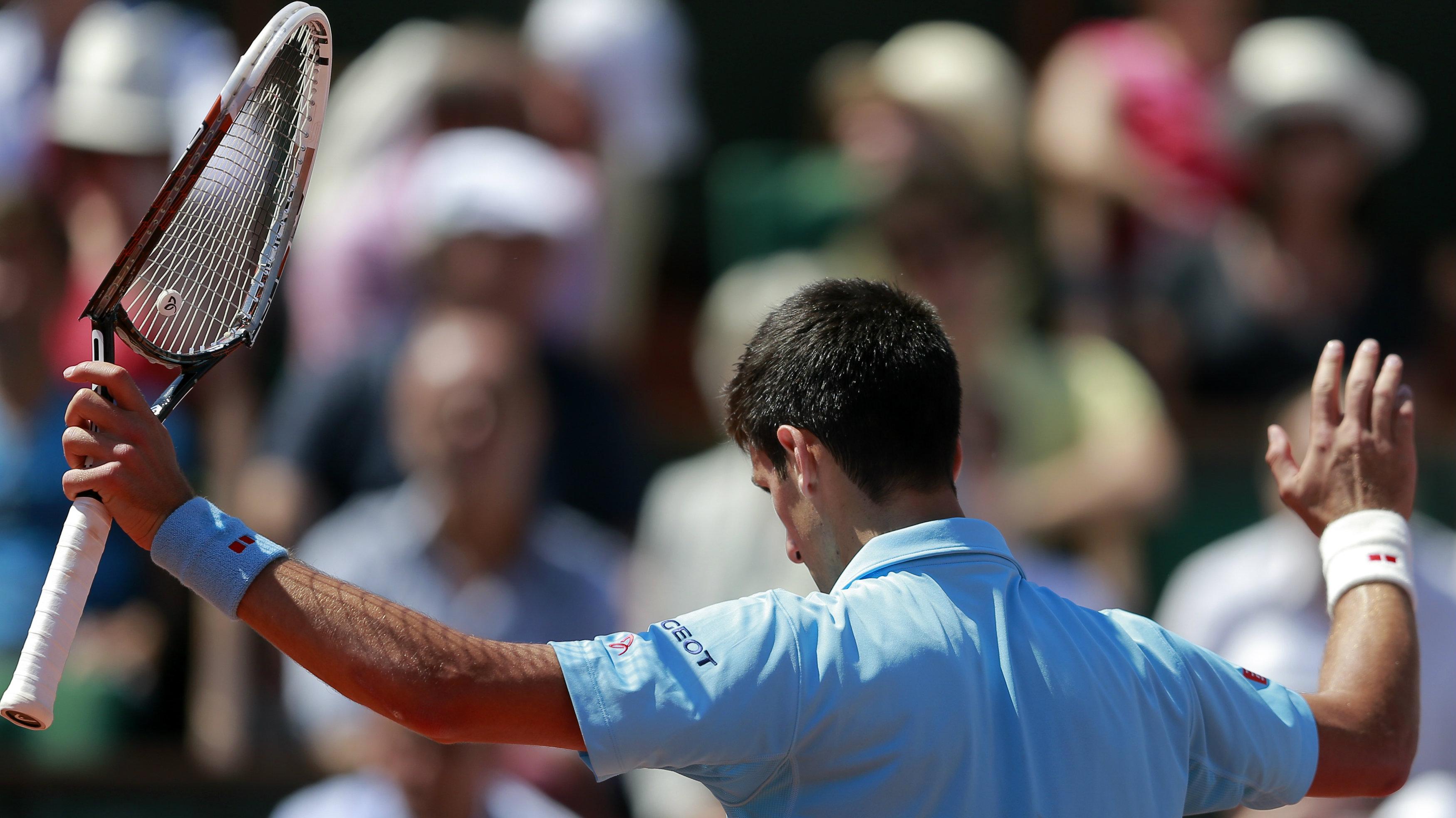 tennis player with broken racket