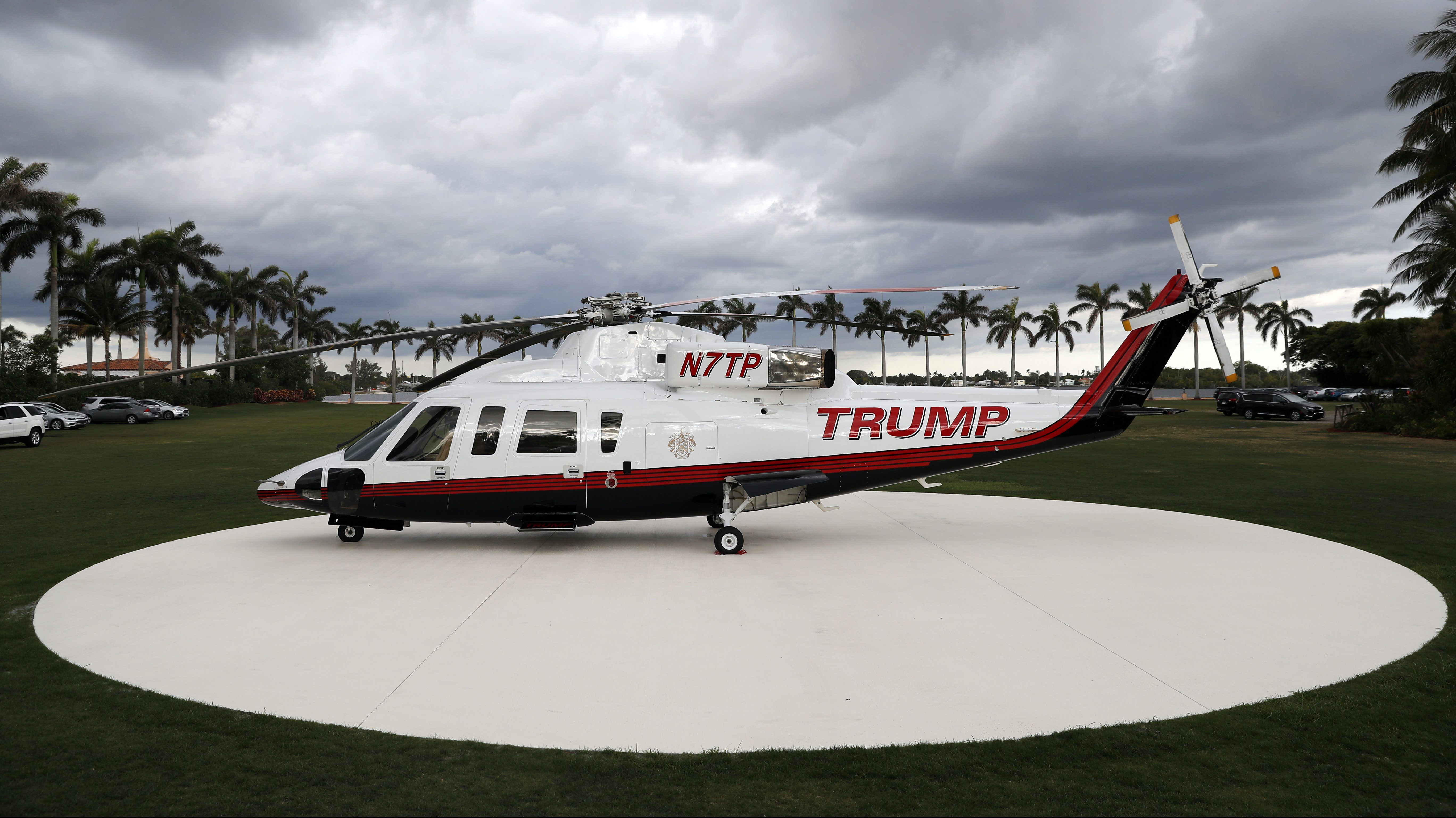 A personal helicopter of President Donald Trump sits on the helipad at Mar-a-Lago, Sunday, April 9, 2017, in Palm Beach, Fla. The helicopter appeared Sunday on the newly paved helipad of Mar-a-Lago, then left a few hours later. The White House didn't respond to questions about the reason the helicopter was there. (AP Photo/Alex Brandon)