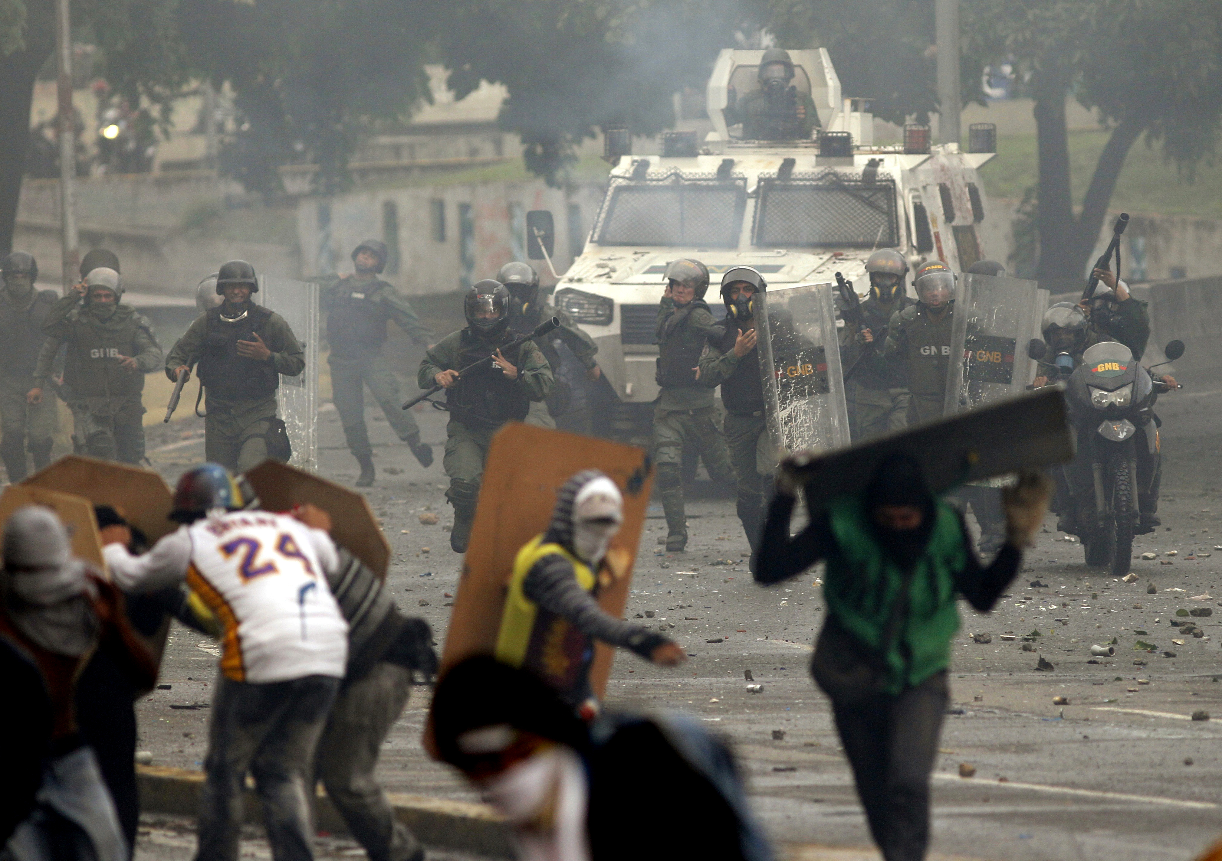Bolivarian National Guards charge on anti-government demonstrators