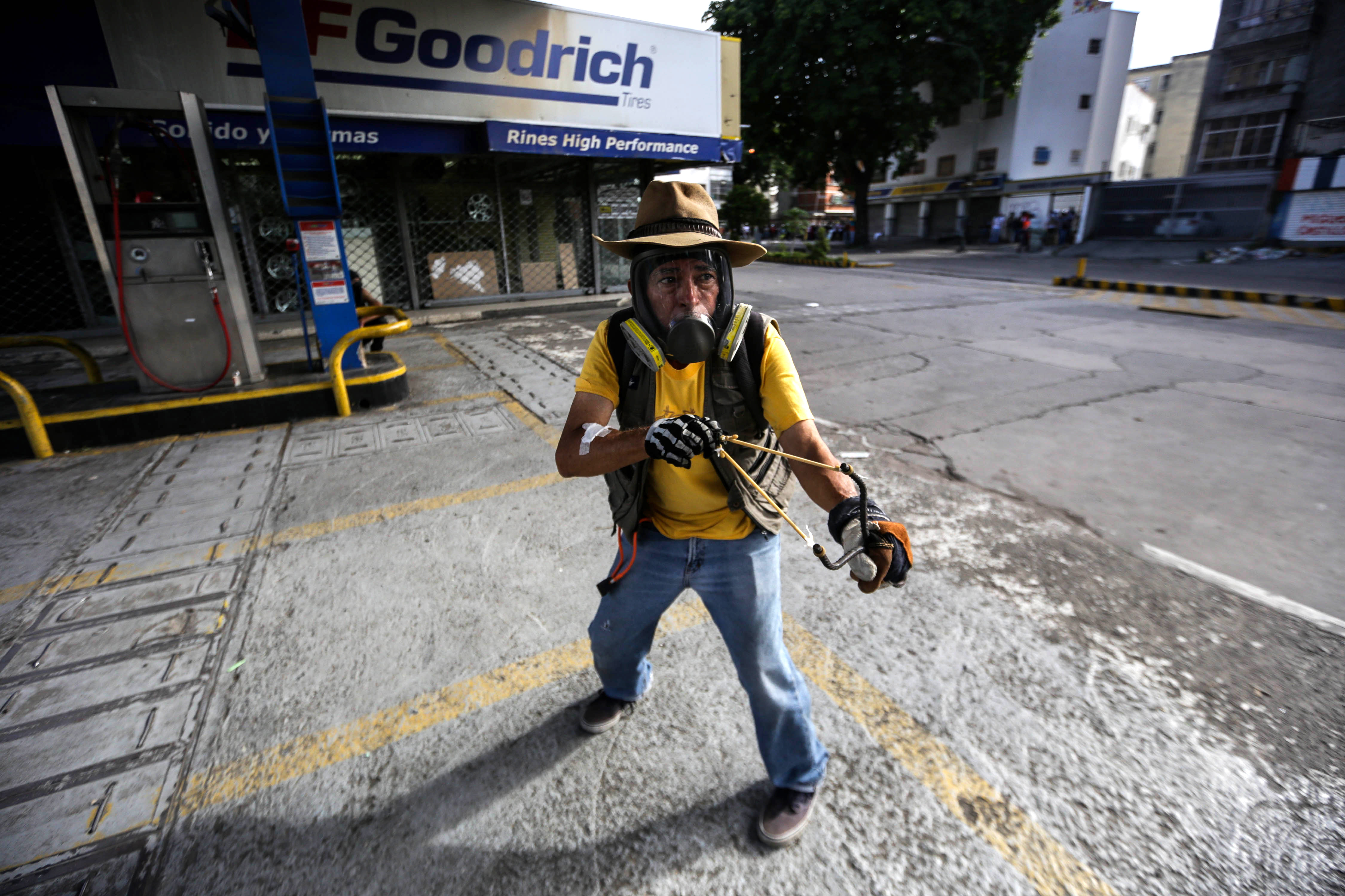 A protestor confronts members of the National Bolivarian Guard
