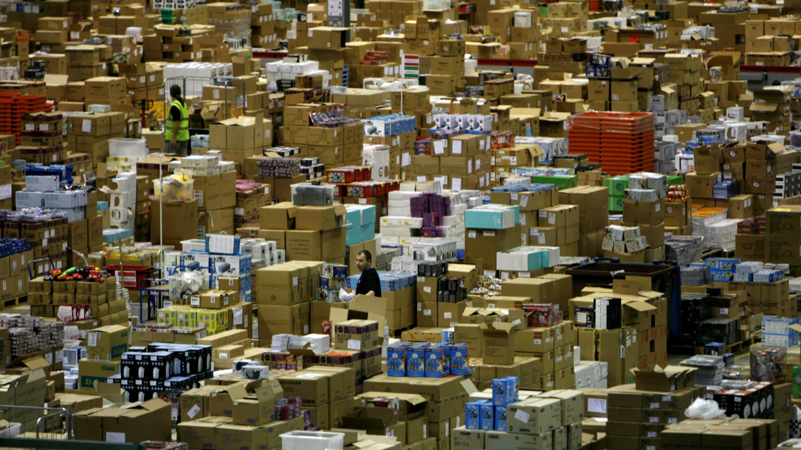Workers are seen in the Amazon.co.uk warehouse in Milton Keynes, north of London, Britain November 17, 2006.