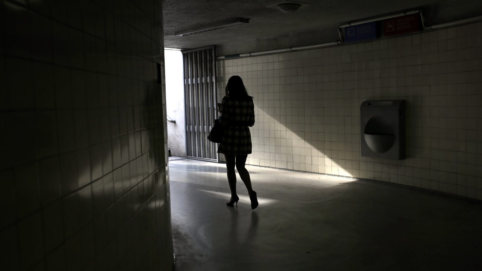 A woman walks out of Lisbon's Saldanha subway station, in Lisbon, Portugal, Wednesday, March 4, 2015. Every working day thousands of commuters use the four line subway network in the Portuguese capital. (AP Photo/Francisco Seco)