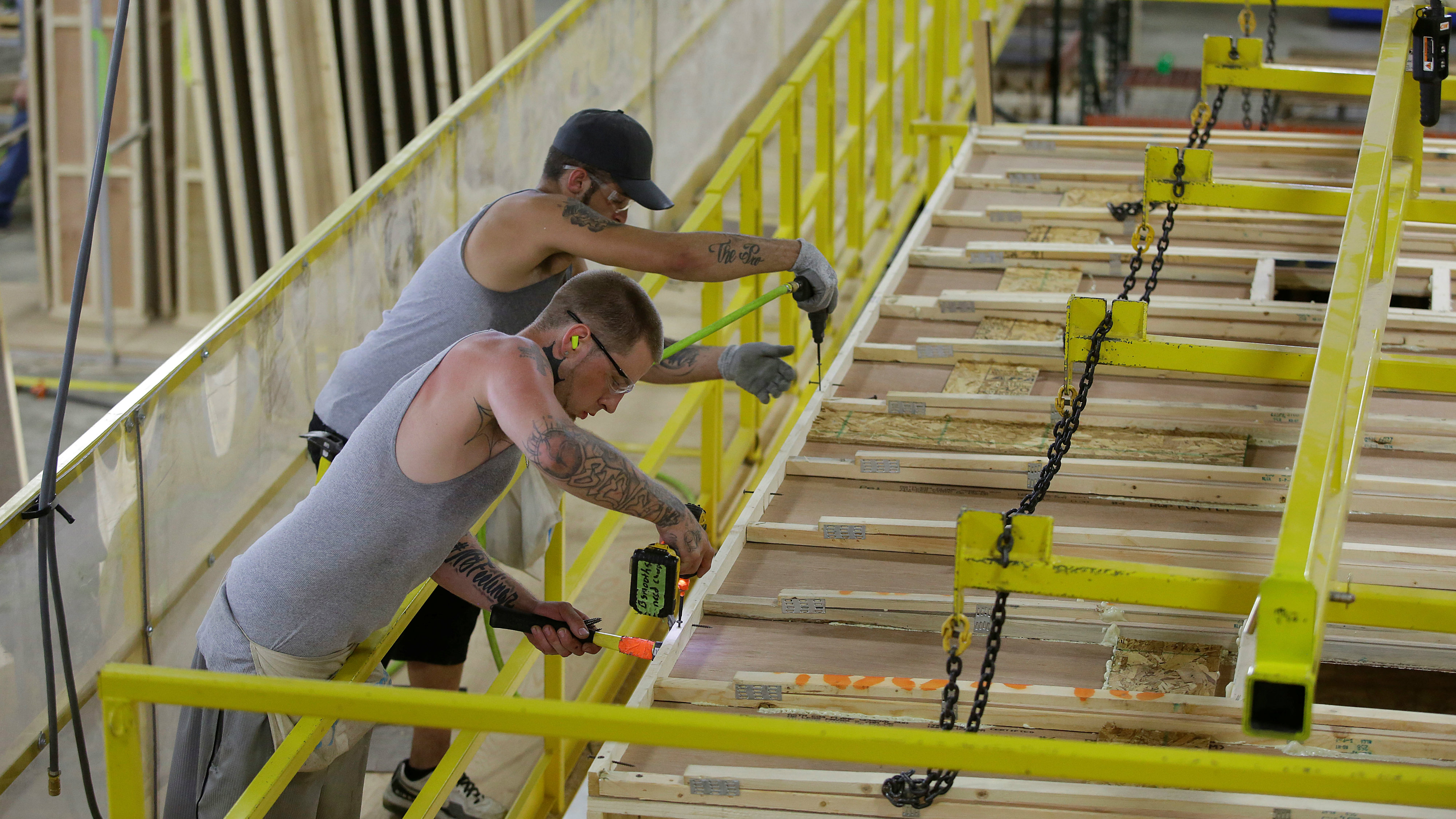 Workers build the roof of a single axel towable Pioneer traditional recreational vehicle at the Thor Industries Heartland RV Assembly Plant in Elkhart, Indiana, U.S. June 13, 2017. Picture taken June 13, 2017.