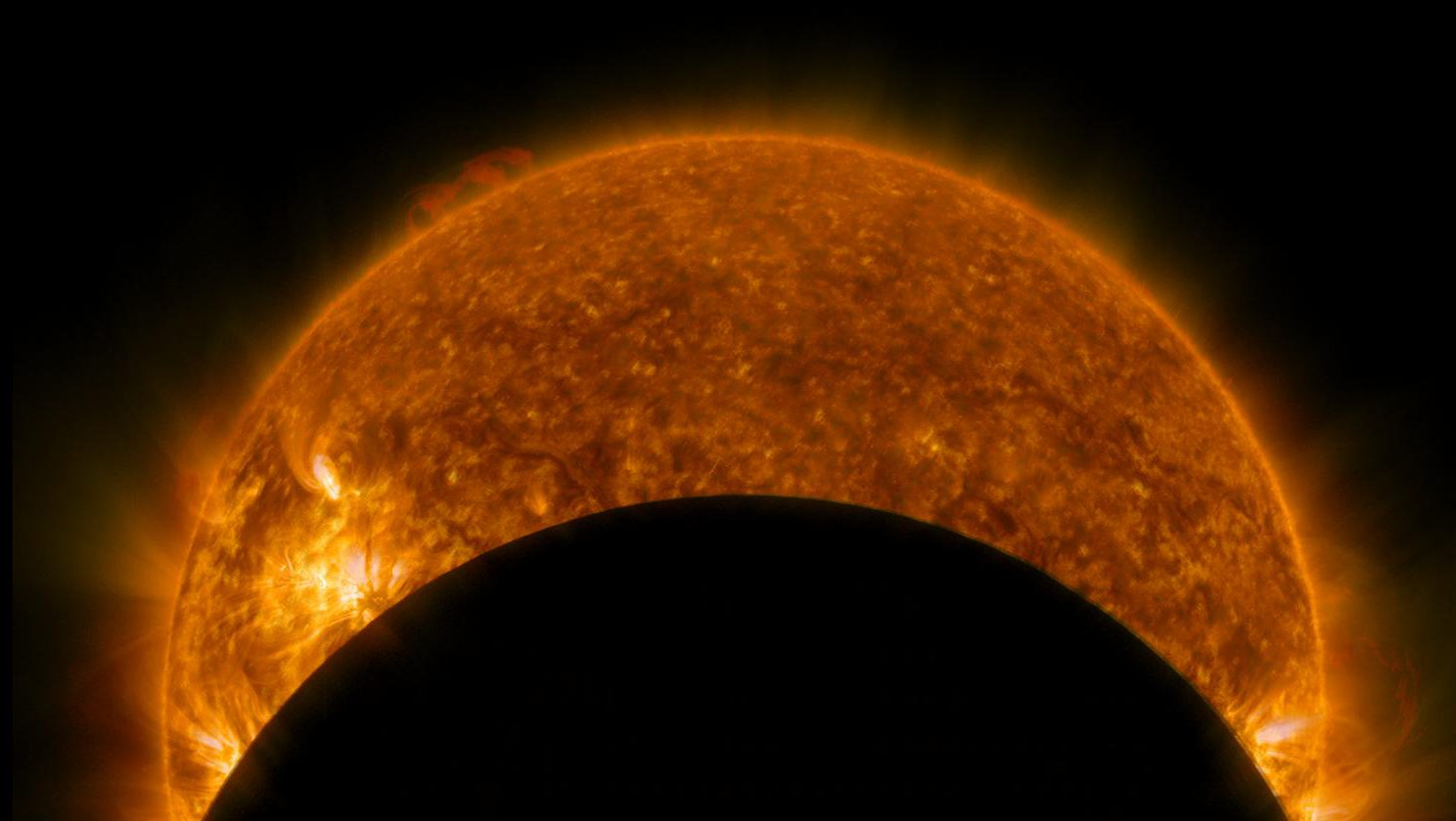 NASA's Solar Dynamics Observatory captured this ultraviolet image of the moon eclipsing the sun on Jan. 31, 2014.