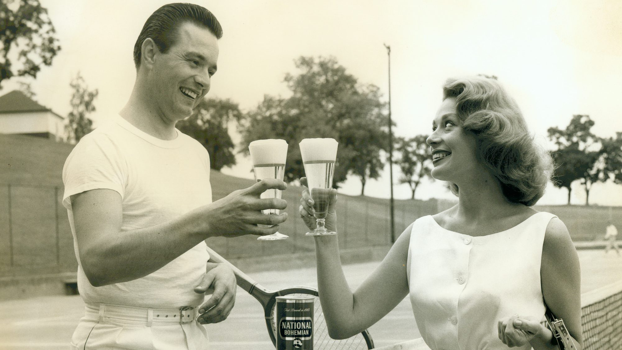 A man and a woman smile at each other in a vintage photo