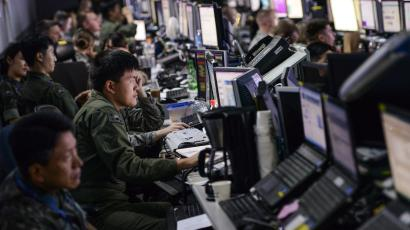 Members from U.S. and Republic of Korea militaries man the Hardened Theater Air Control Center, at Osan Air Base, ROK, during the first day of Ulchi Freedom Guardian, Aug. 17, 2015. UFG is held annually to strengthen the U.S.-ROK alliance commanders' and staff members' ability to translate information into actionable decision-making.