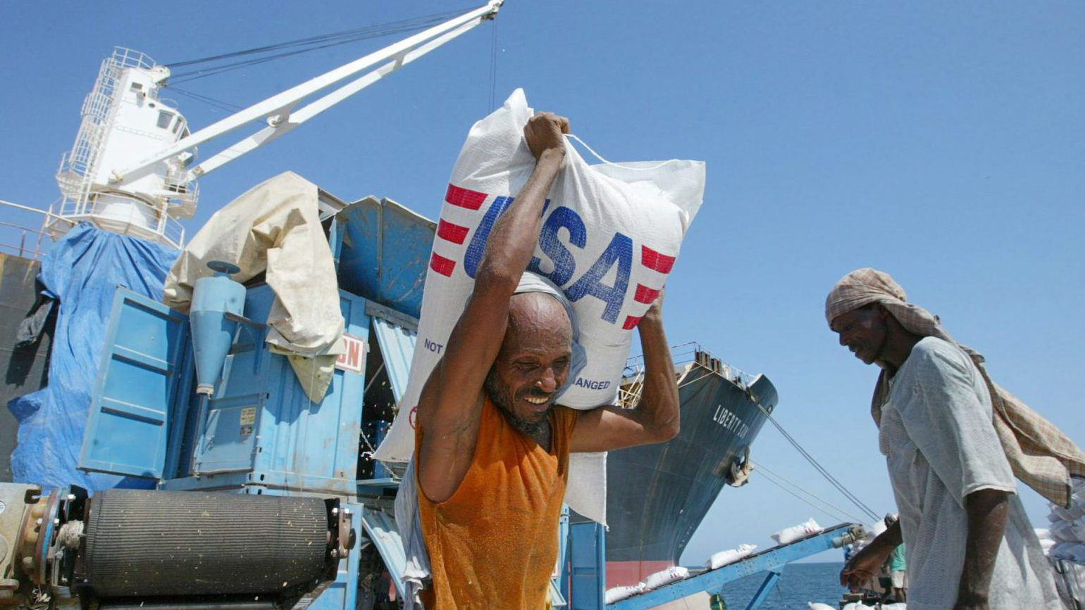 Workers unloading food aid at a port in Eritrea.