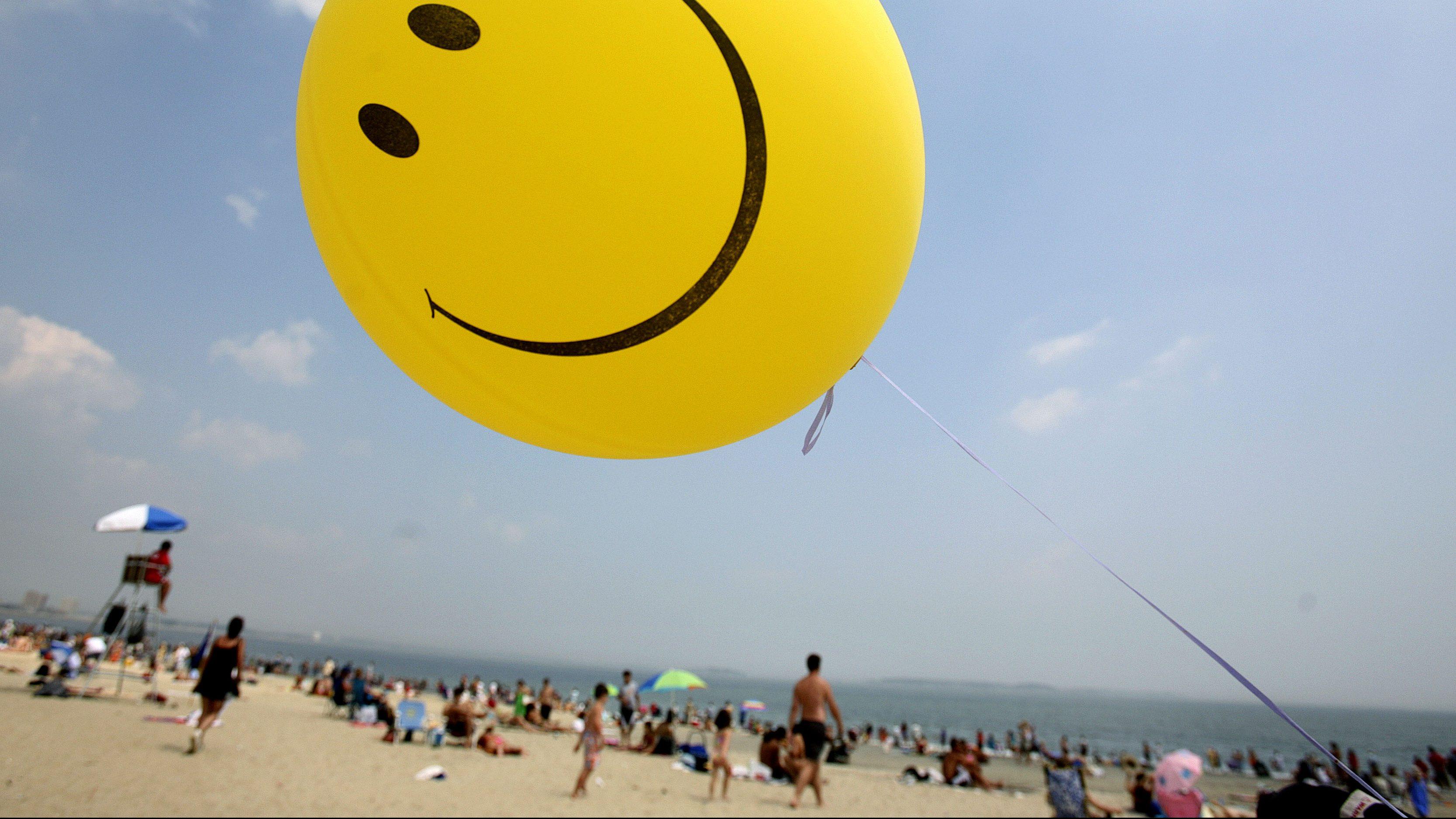 A smiley-face balloon floats over Revere