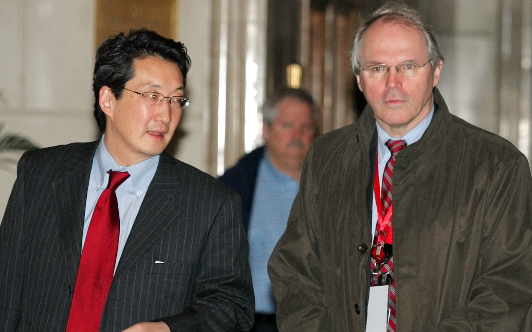 U.S. Assistant Secretary of State Christopher Hill, right, and Victor Cha, the U.S.  National Security Council's director for Asian Affairs, walk through their hotel lobby before heading to a second day of six party talks on North Korea's nuclear program, in Beijing Tuesday March 20, 2007.