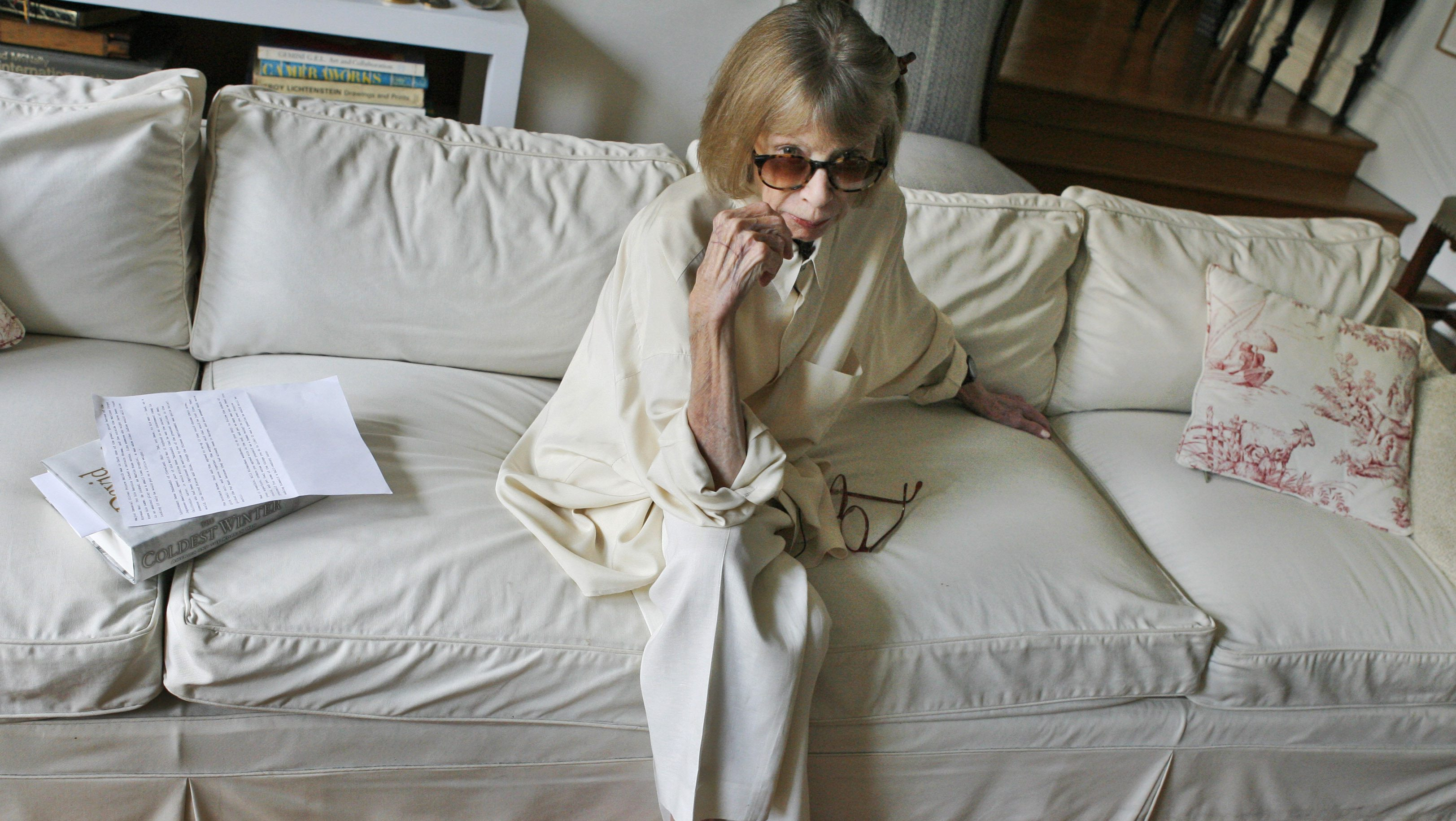 """Author Joan Didion poses for a photograph in her New York apartment, Thursday, Sept. 27, 2007, before being interviewed for a short promotional film for David Halberstam's """"The Coldest Winter,"""" the final book by the Pulitzer Prize-winning journalist who was killed last spring in a California car accident. (AP Photo/Kathy Willens)"""