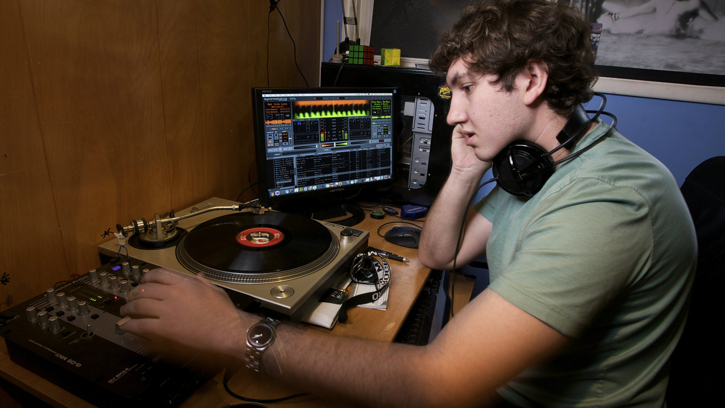A DJ practices his electronic music DJ skills, as he spends hours in his room broadcasting music online for his friends,