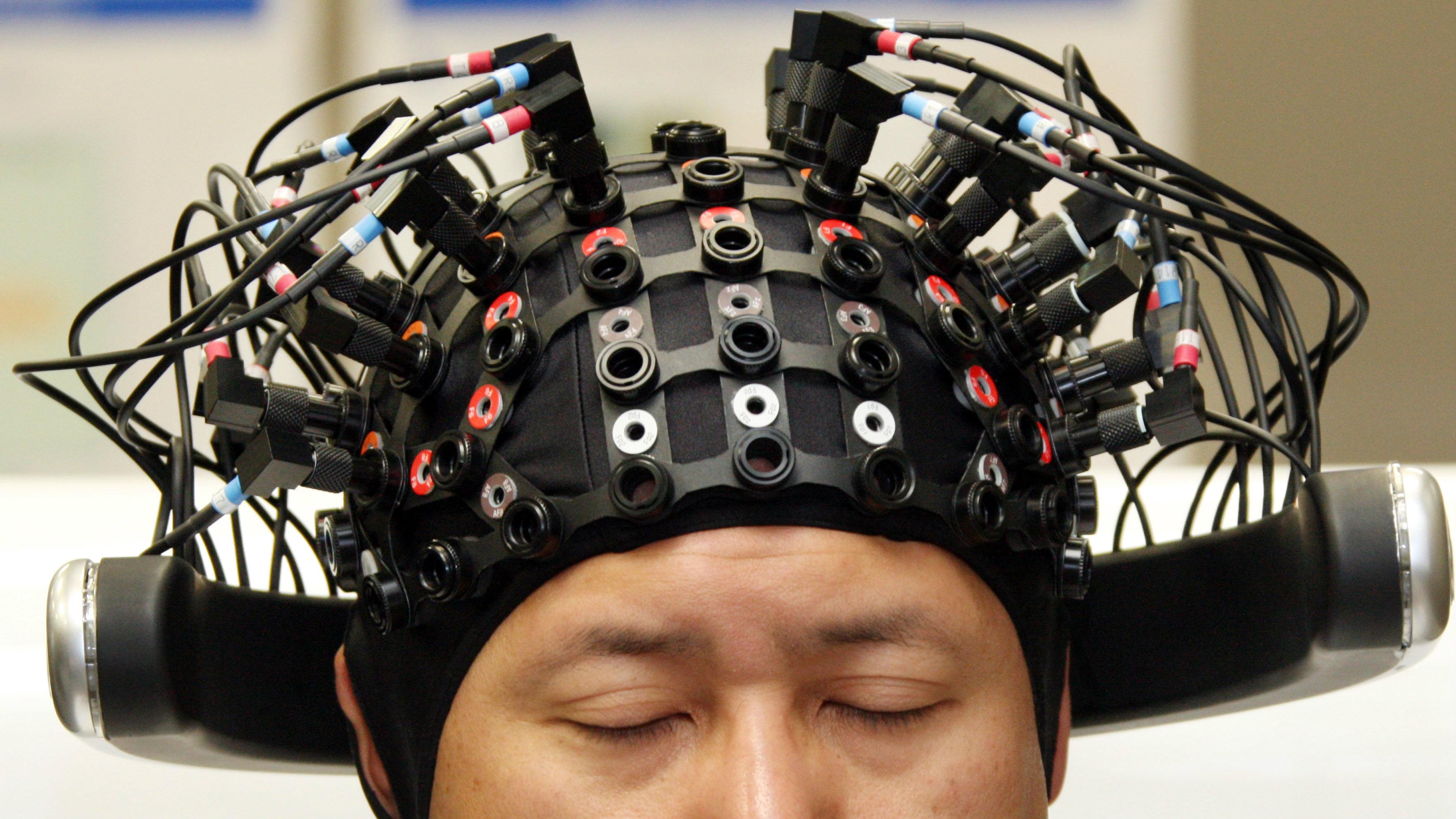 Man wearing brain linking technology.