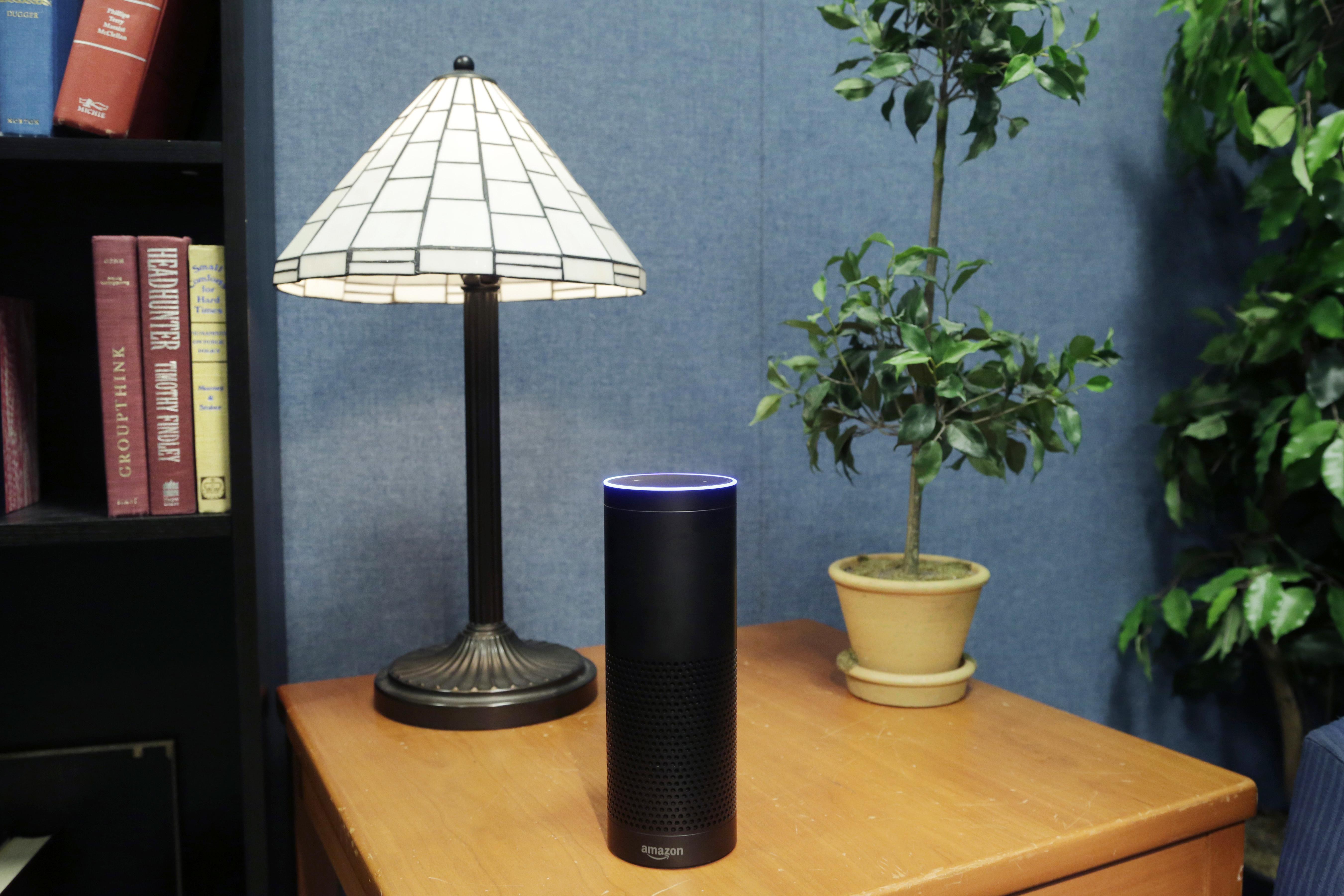 An Amazon Echo on a table.