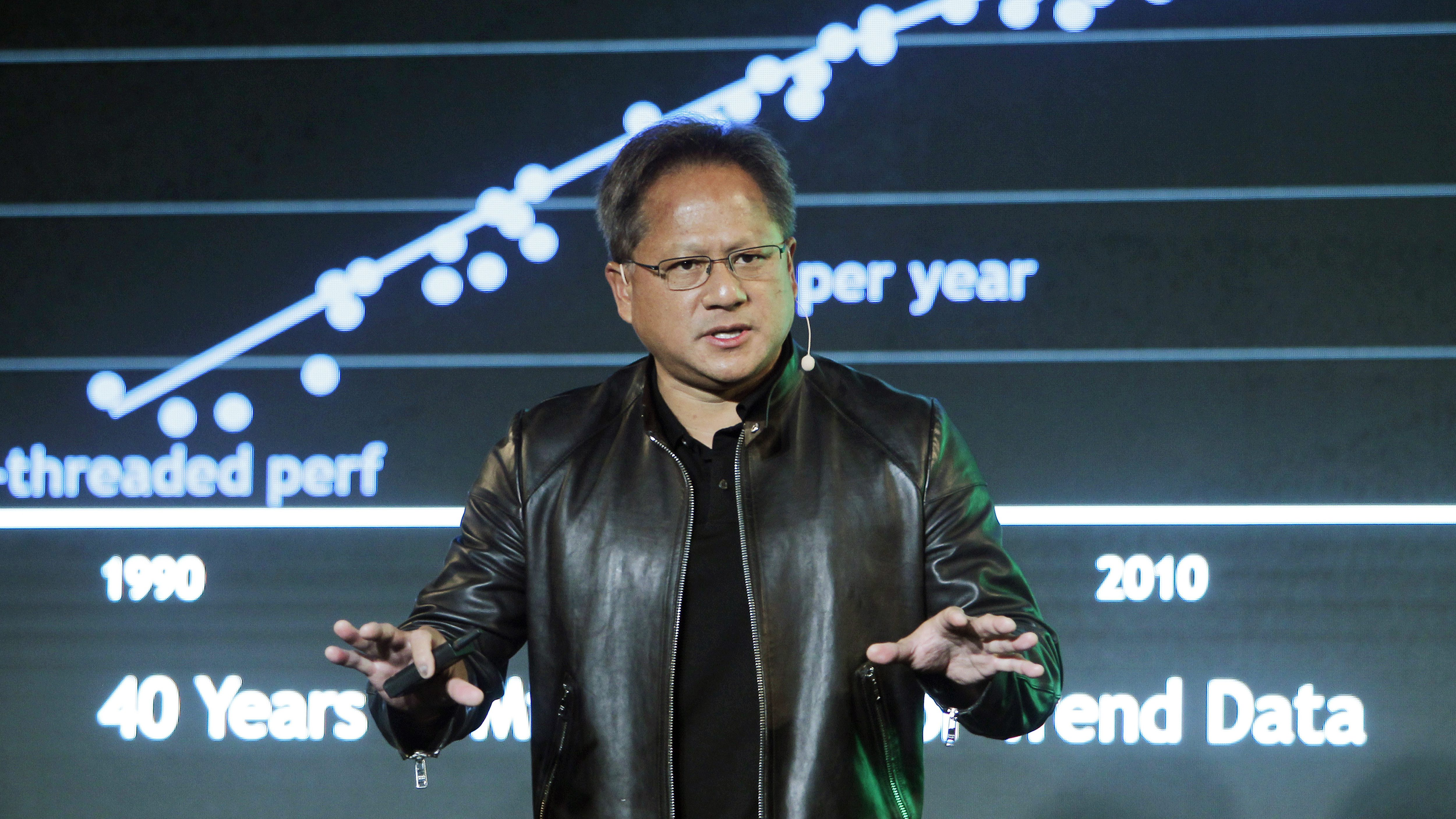 NVIDIA CEO Jen-Hsun Huang delivers a speech about AI and gaming during the Computex Taipei exhibition at the world trade center in Taipei, Taiwan, Tuesday, May 30, 2017. (AP Photo/Chiang Ying-ying)