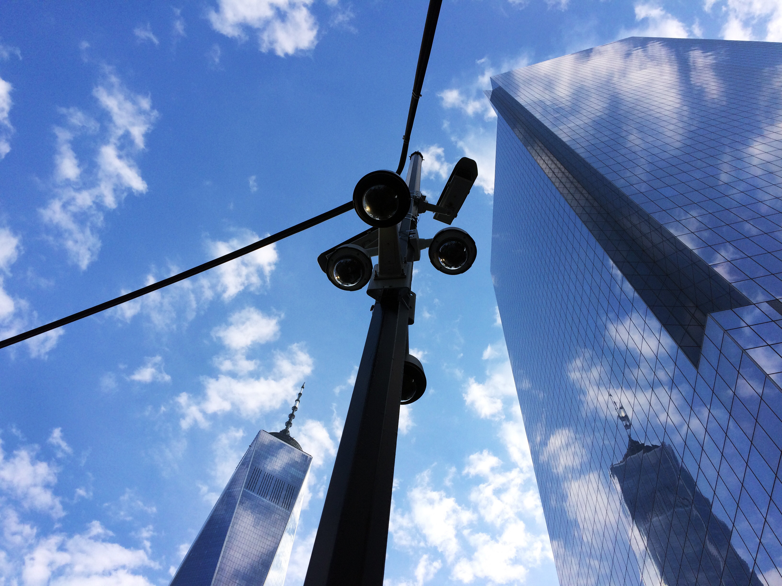 Security cameras provide surveillance of streets near One World Trade Center, left, and 4 World Trade Center, Tuesday, June 13, 2017 in New York. (AP Photo/Mark Lennihan)