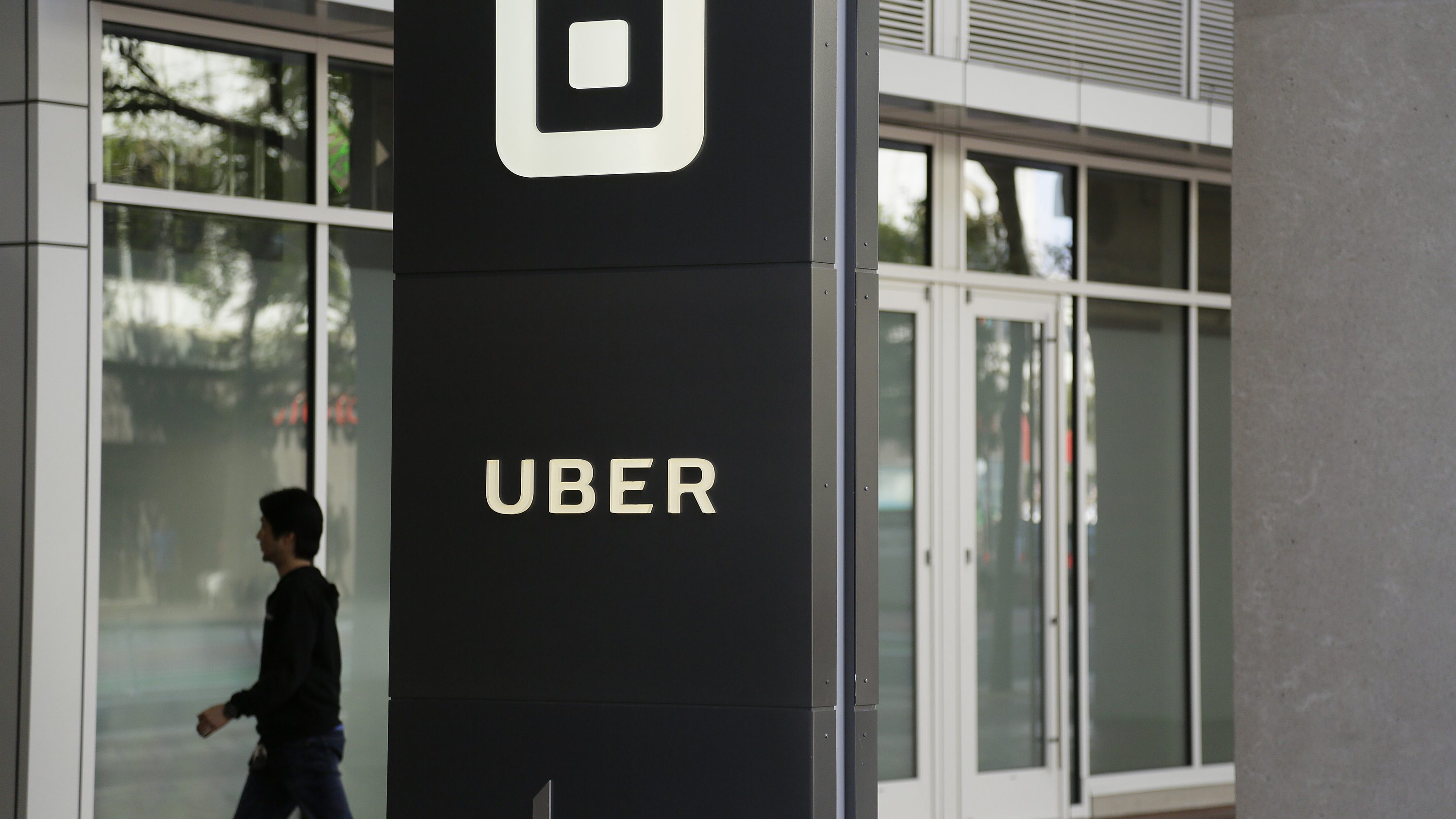 A man walks into the building that houses the headquarters of Uber Wednesday, June 21, 2017, in San Francisco.