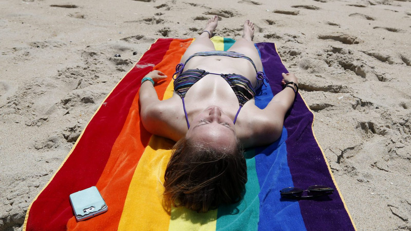 Erica Sleifer of Neptune, N.J., rests on the beach in Asbury Park, N.J., Wednesday, June 21, 2017. June 21 is the summer solstice, the longest day of the year, which traditionally marks the first official day of summer.
