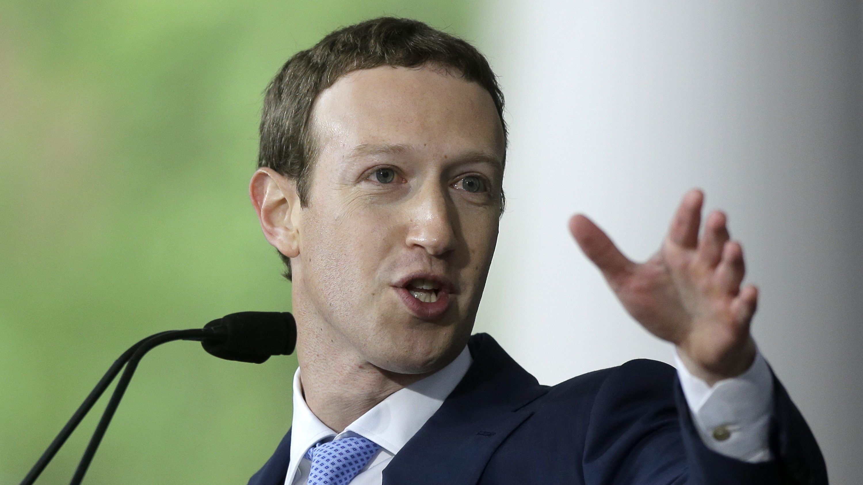 In this May 25, 2017, file photo, Facebook CEO and Harvard dropout Mark Zuckerberg delivers the commencement address at Harvard University commencement exercises in Cambridge, Mass. President Donald Trump's Interior Department prevented Glacier National Park's superintendent from accompanying Facebook founder Mark Zuckerberg on a recent park tour to save money, not to mute criticism over climate change, a spokeswoman for the agency said Thursday, July 20.