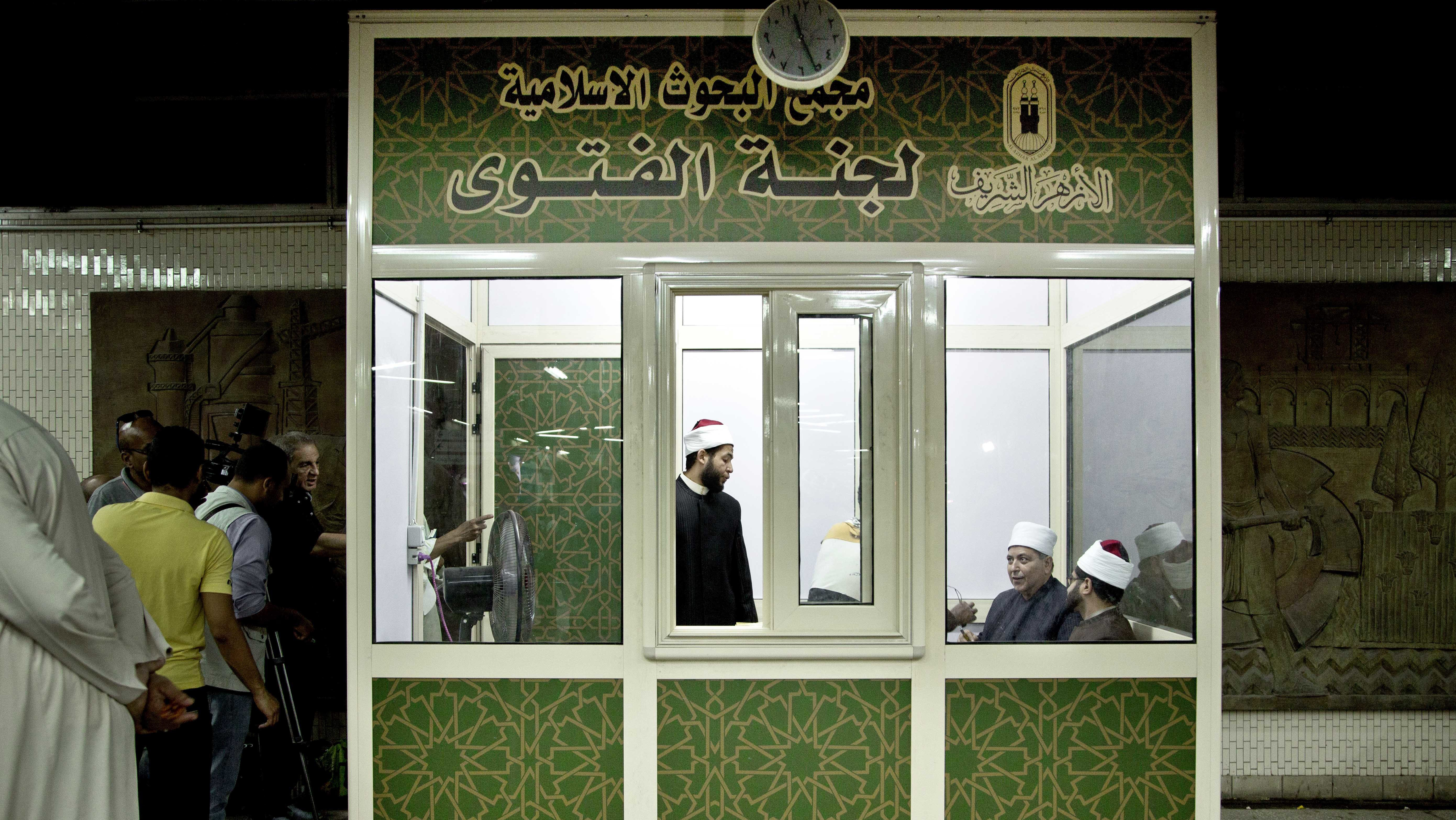Al-Azhar clerics wait to answer commuters questions inside a Fatwa Kiosk, at the Al Shohada'a metro station, in Cairo, Egypt, Tuesday, July 25, 2017. Al-Azhar, the Sunni Muslim world's foremost religious institution, has set up booths in Cairo metro stations to provide religious edicts to commuters in the latest bid to dispel religious misconceptions seen as fostering Islamic militancy in the country, which is targeting mainly security personnel and Christians.
