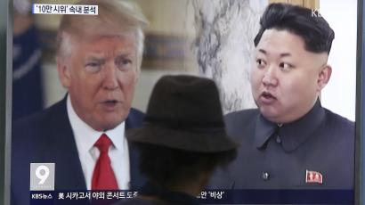 Viewer watching news coverage of president Trump's and Kim Jong-Un's responses to threats of nuclear war.