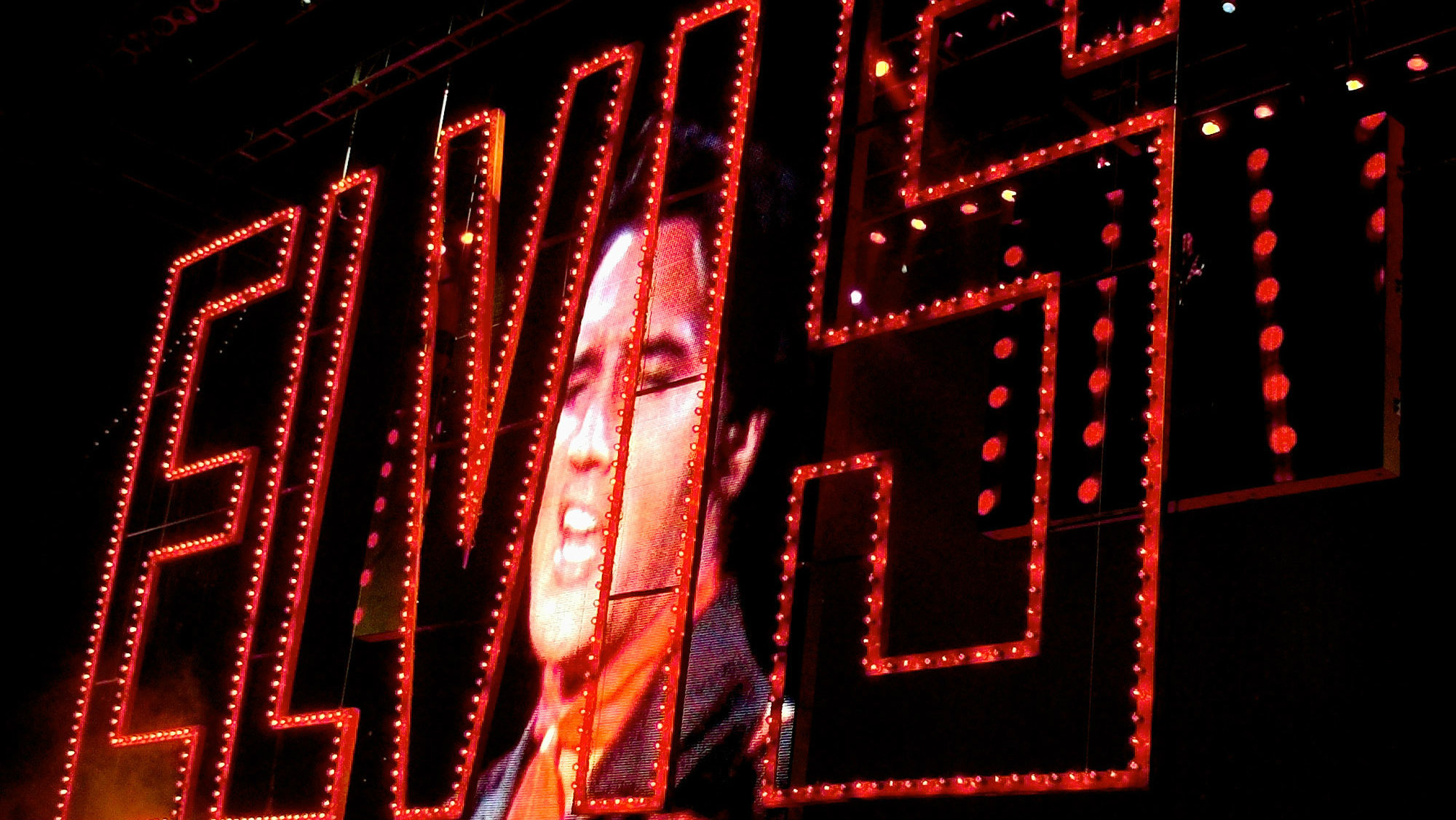 Video of Elvis Presley singing as his band plays below at the start of the Elvis Presley 25th Anniversary Concert in Memphis, Tenn.