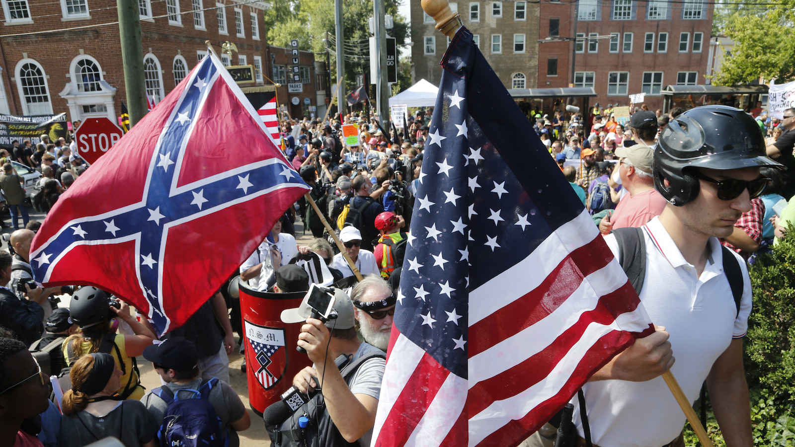Alt Right demonstrators walk into Lee park surrounded by counter demonstrators in Charlottesville, Va., Saturday, Aug. 12, 2017.  (AP Photo/Steve Helber)