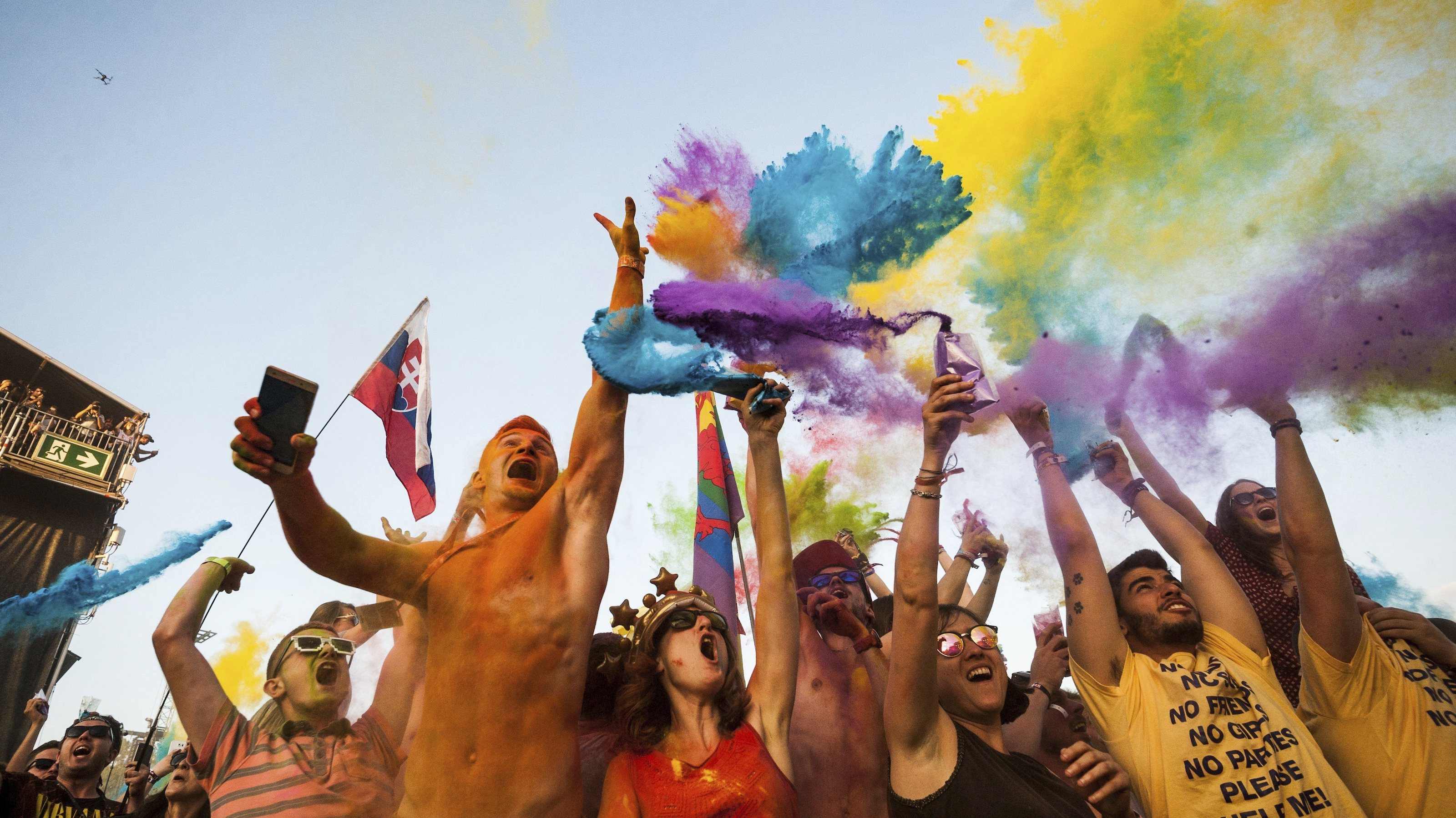 Festival goers participate in a color party at the 25th Sziget (Island) Festival on Shipyard Island, Northern Budapest, Hungary, Tuesday, Aug. 15, 2017. The festival is one of the biggest cultural events of Europe offering art exhibitions, theatrical and circus performances and above all music concerts in eight days. More than 100 programs a day and performers from over 52 countries entertain the nearly 500 thousands visitors. (Marton Monus/MTI via AP)
