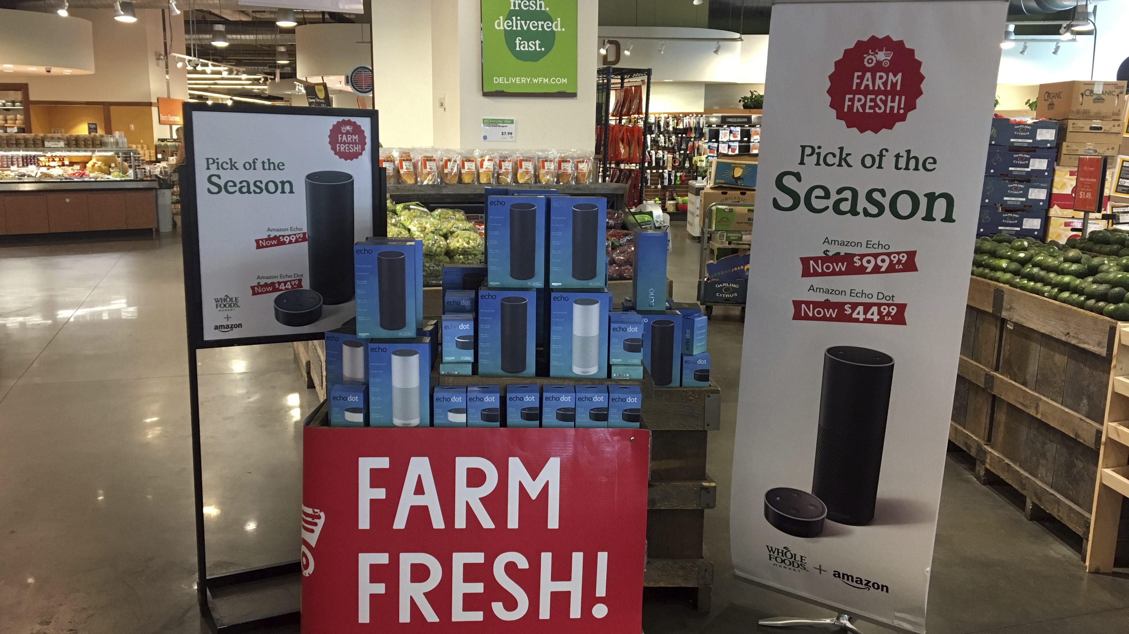 Amazon's Echo and Echo Dot appear on sale at a Whole Foods Market in New York, Monday, Aug. 28, 2017. Amazon has completed its $13.7 billion takeover of organic grocer Whole Foods, and the e-commerce giant is wasting no time putting its stamp on the company. Prices were lowered; Whole Foods brands will soon be on Amazon's site; and Amazon's Prime members could soon get discounts at Whole Foods. The deal could also spur changes in the wider grocery industry. (AP Photo/Joseph Pisani)