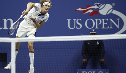 Alexander Zverev of Germany serves to opponent Darian King of Barbados during their opening round match at the U.S. Open tennis tournament in New York, Tuesday, Aug. 29, 2017. (AP Photo/Kathy Willens)