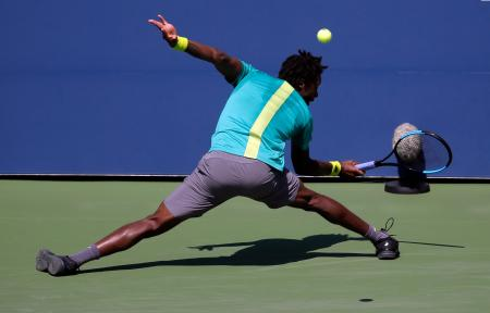 Gael Monfils, of France, returns a shot from Jeremy Chardy, of France, during the first round of the U.S. Open tennis tournament, Wednesday, Aug. 30, 2017, in New York. (AP Photo/Seth Wenig)