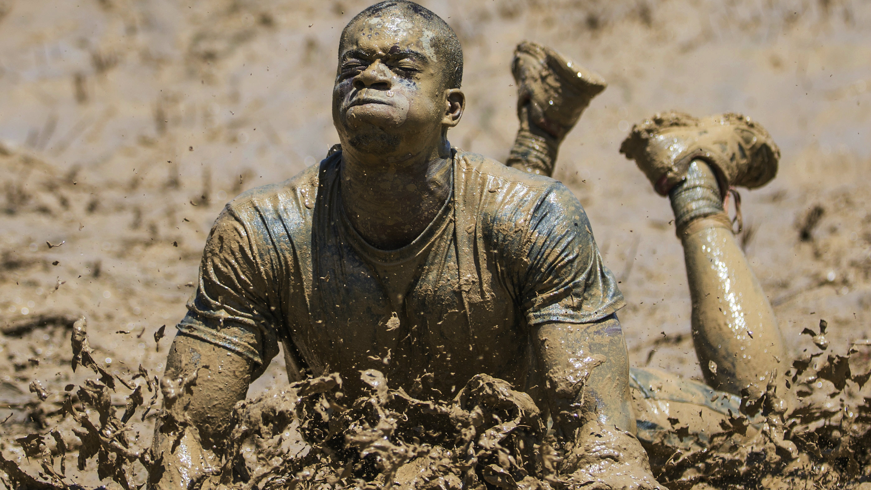 Man completing the Tough Mudder obstacle course.