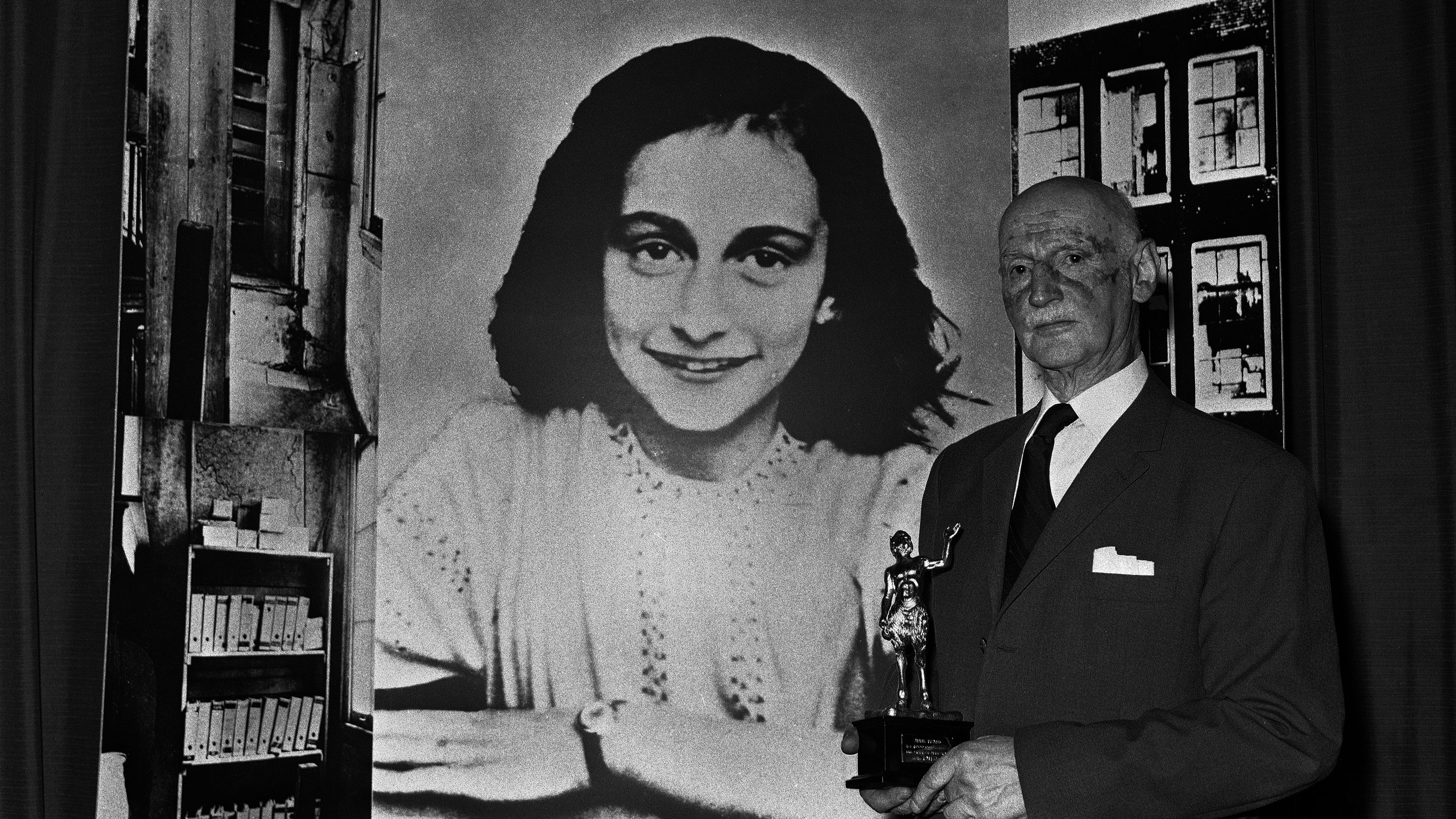 Dr. Otto Frank holds the Golden Pan award, given for the sale of one million copies of the famous paperback, ?The Diary of Anne Frank?. The story of the Jewish family who went into hiding in 1942 in Amsterdam, where they remained undiscovered for two years. After discovery and eventual death, the diary was returned to Dr. Frank, the families only survivor. The award was made in London on June 14, 1971 at the Waldorf Hotel. (AP Photo/Dave Caulkin)