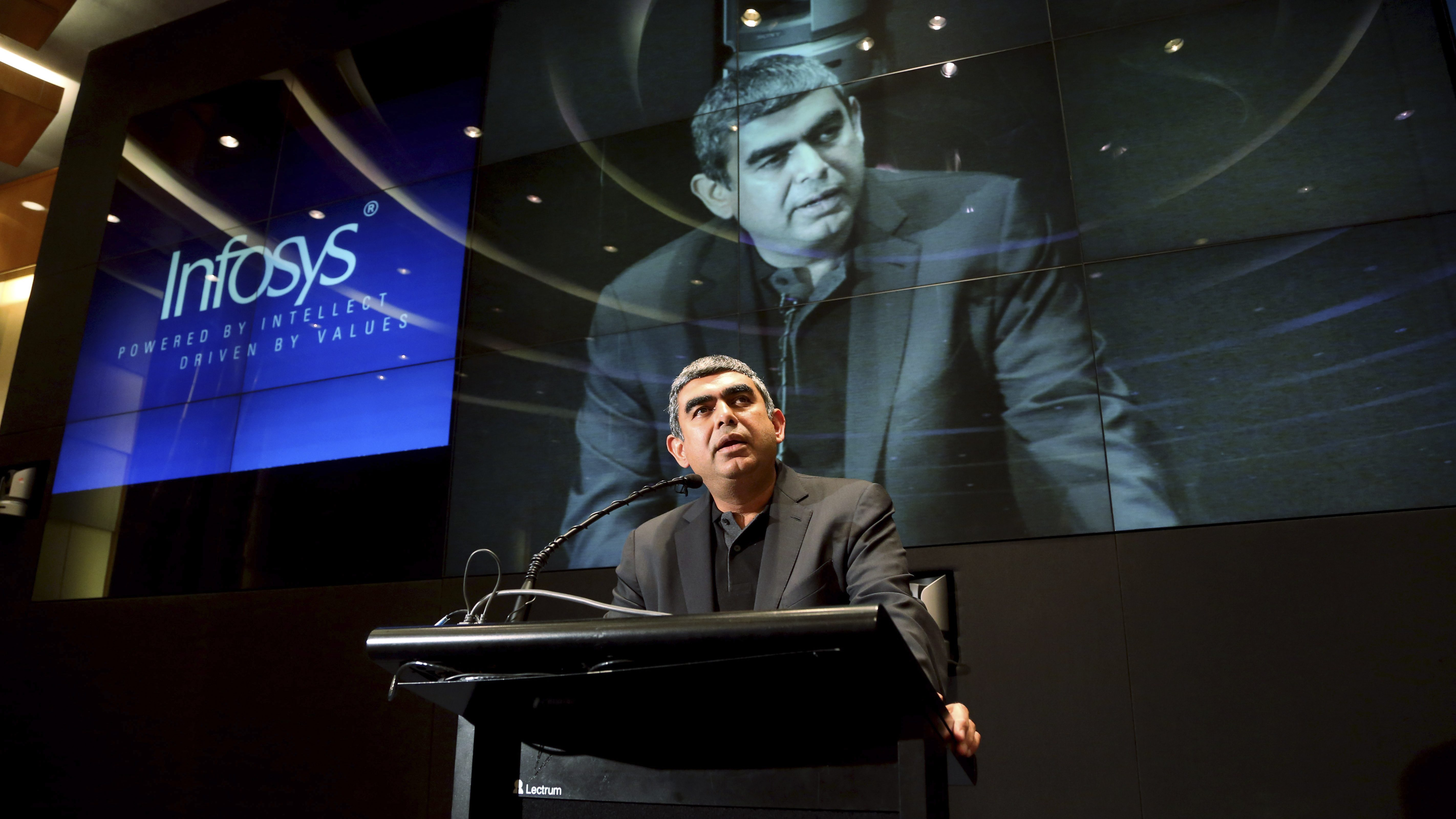 "Vishal Sikka speaks during a press conference after he was announced the new chief executive officer and managing director of Infosys at its headquarters in Bangalore, India, Thursday, June 12, 2014. Sikka said Thursday he felt honored to lead India's second-largest technology outsourcer and was looking forward to working with ""talented Infoscions"" around the world."