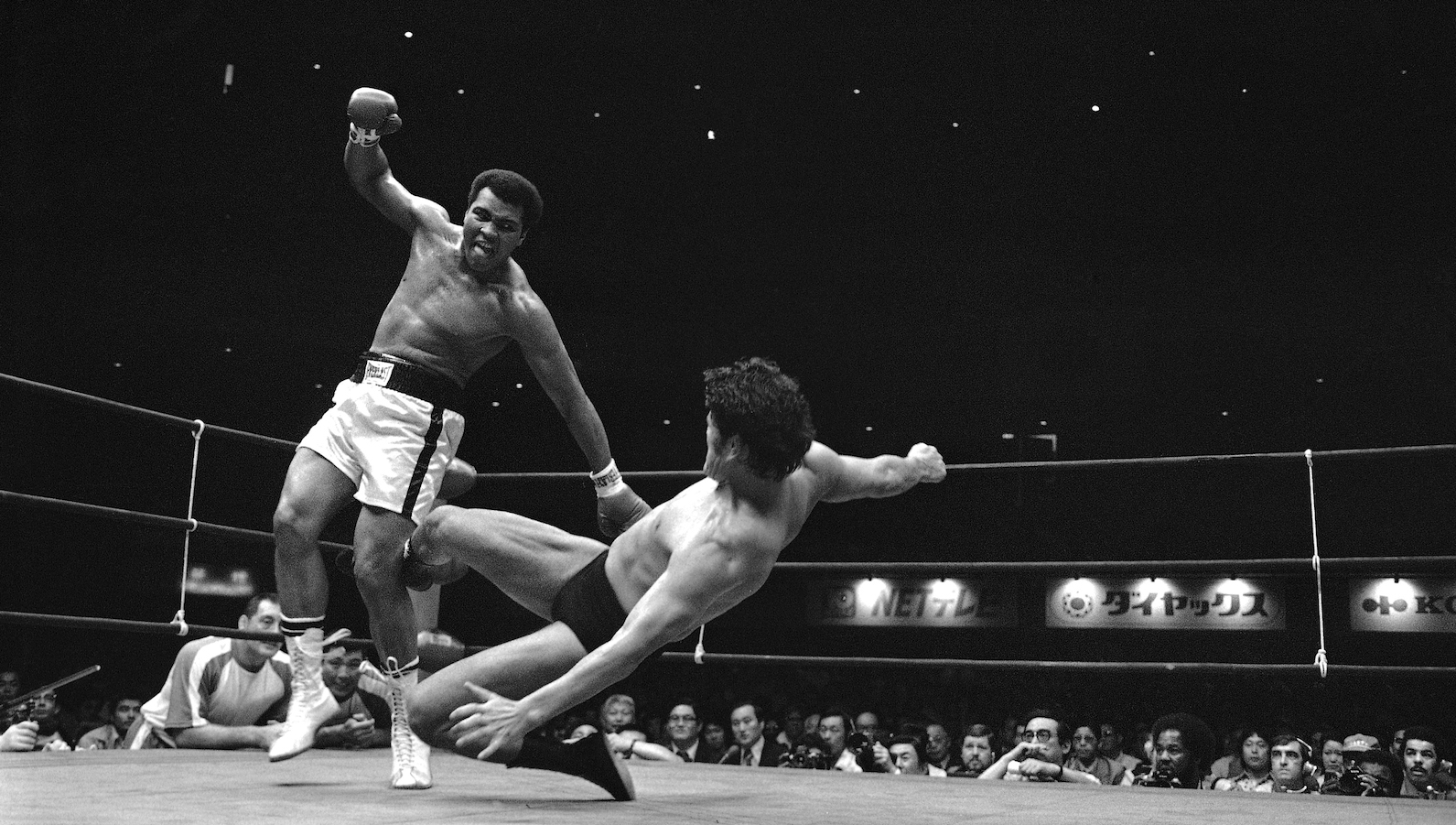 Antonio Inoki kicks Muhammad Ali to pull him down on the canvas 8th round of their 15-round of the World Martial Arts Championship fight in Tokyo on Saturday, June 26, 1976.  Both fighters fought to a draw. (AP Photo)
