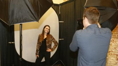 Woman posing for professional photo.