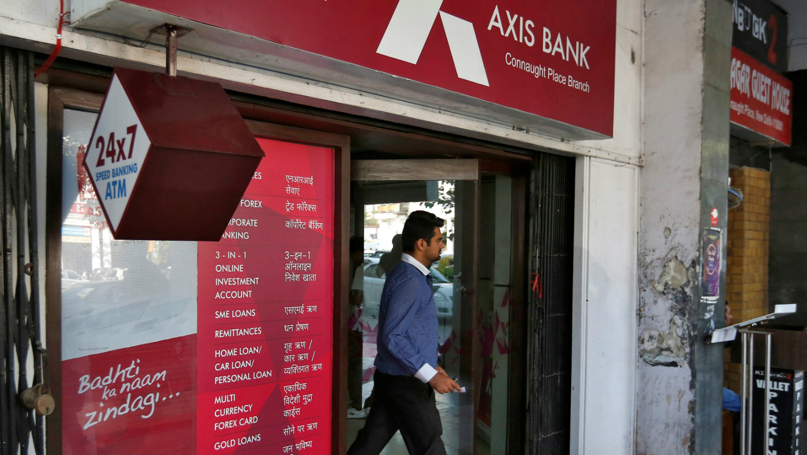A man leaves an Axis Bank automated teller machine (ATM) in New Delhi, India, October 20, 2016.