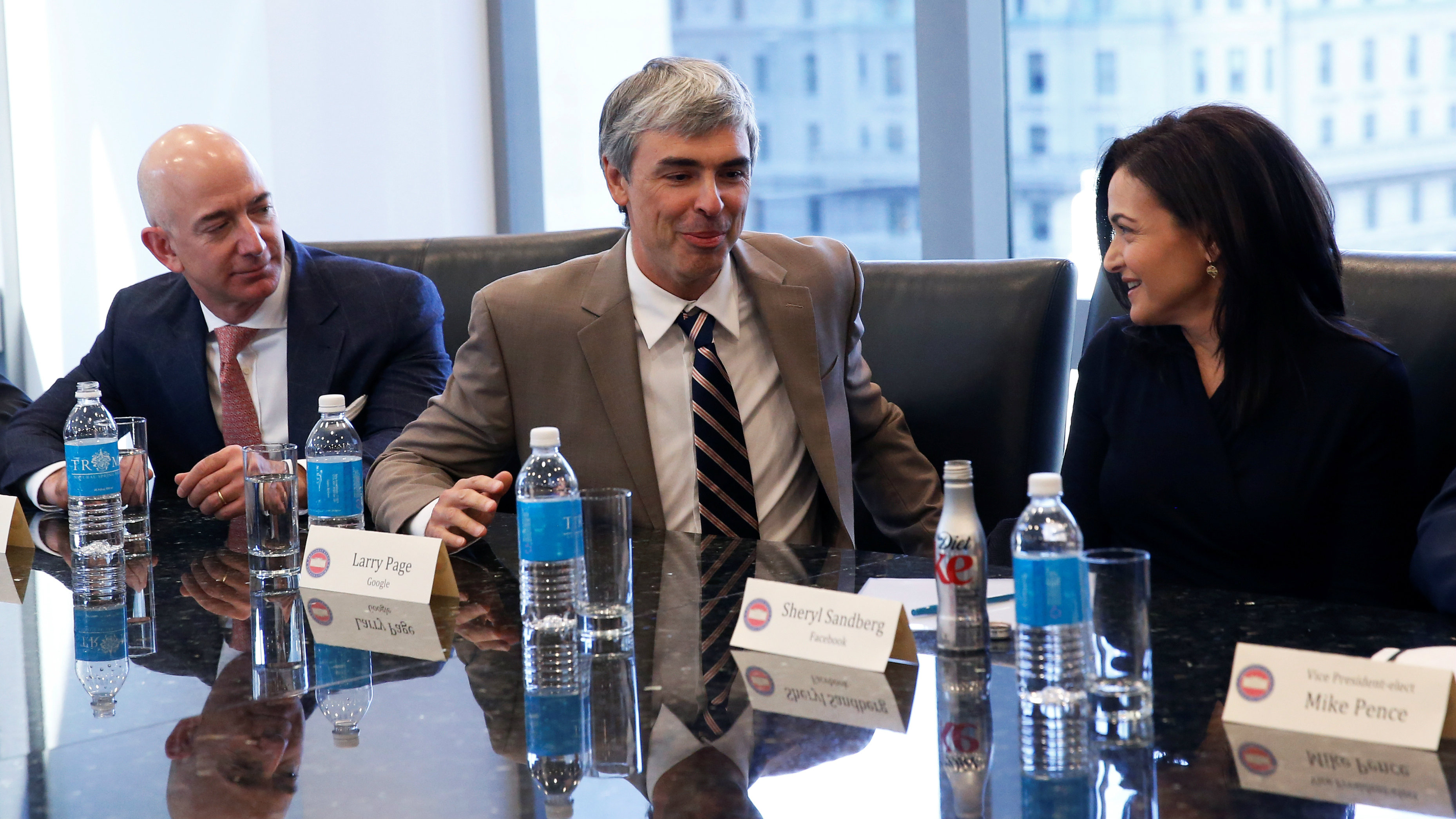 Larry Page (C), CEO and Co-founder of Alphabet, speaks while Sheryl Sandberg, Chief Operating Officer of Facebook (R), and Amazon CEO Jeff Bezos look on during a meeting with U.S. President-elect Donald Trump and technology leaders at Trump Tower in New York U.S., December 14, 2016.