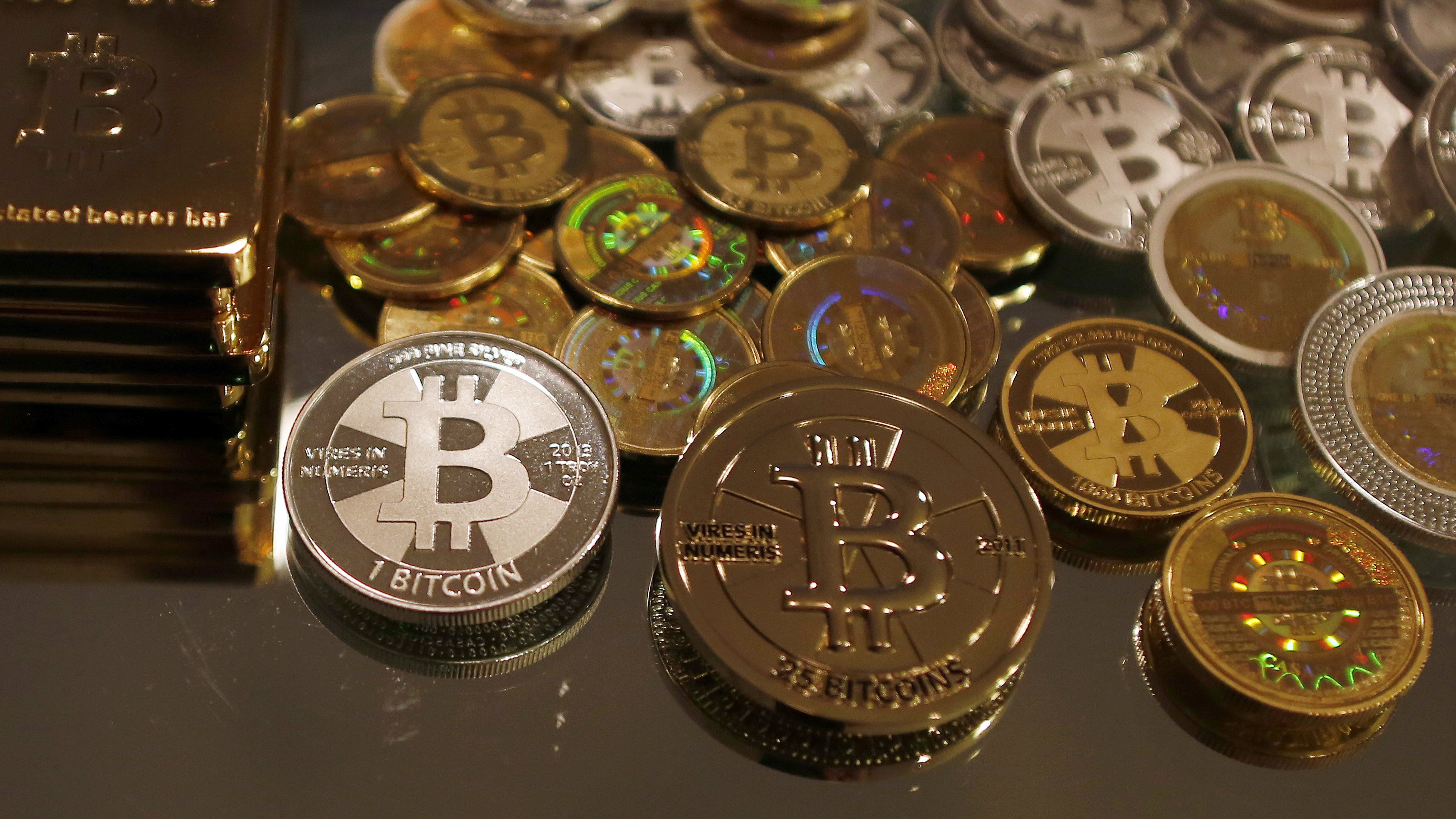 Bitcoins created by enthusiast Mike Caldwell are seen in a photo illustration at his office in Sandy, Utah, September 17, 2013. Caldwell produces physical coins Bitcoins, which have been around since 2008, are a form of electronic money that can be exchanged without using traditional banking or money transfer systems.