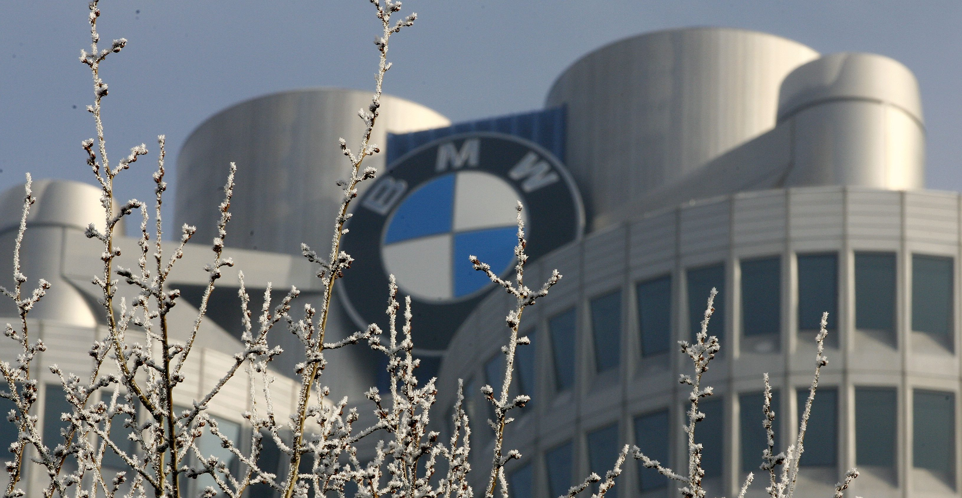Frost covered branches are seen in front of the tower of Bavarian luxury carmaker BMW in Munich, December 21, 2007.
