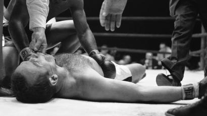 Ingemar Johansson (down on his back) failed to regain consciousness for several minutes after Floyd Patterson, kneeling by him, knocked him out in fight June 20, 1960. Floyd Patterson shows concern.