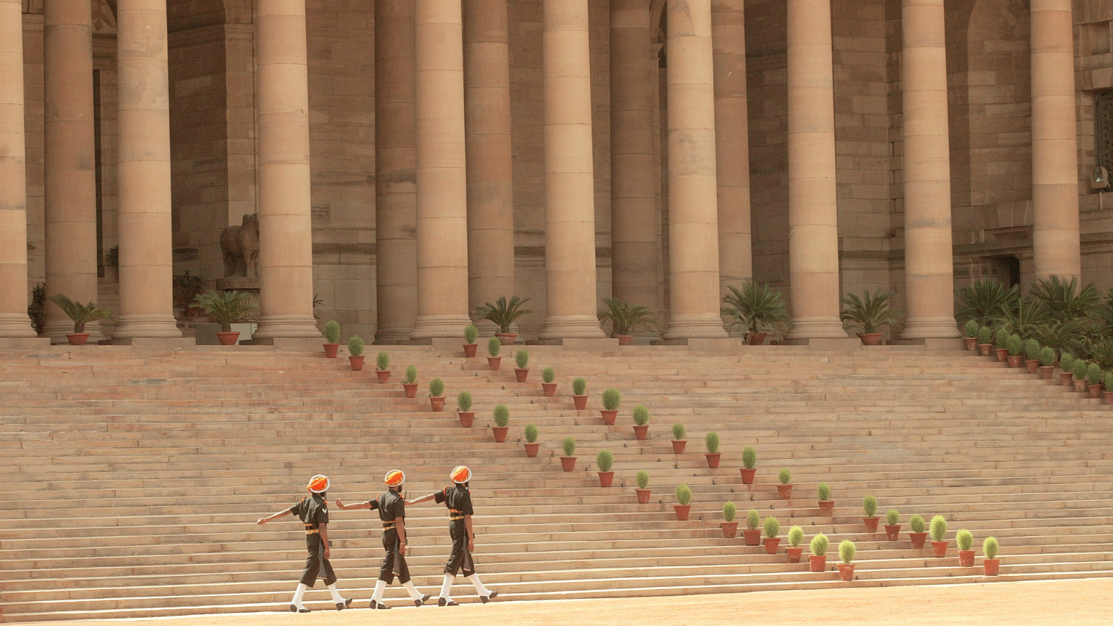 Indian Army soldiers march past Rashtrapati Bhavan. The building is the crowning glory of the British empire and architecture in India, designed by Sir Edwin Lutyens and completed in 1929, it is bigger than the Palace of Versailles.