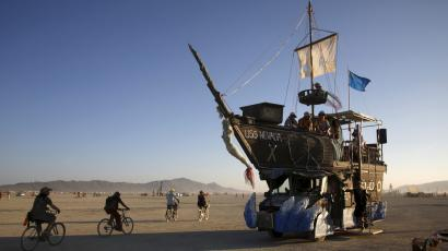 "The USS Nevada, a Mutant Vehicle, carries participants on the Playa during the Burning Man 2015 ""Carnival of Mirrors"" arts and music festival in the Black Rock Desert of Nevada, August 31, 2015. Approximately 70,000 people from all over the world are gathering at the sold-out festival to spend a week in the remote desert to experience art, music and the unique community that develops."