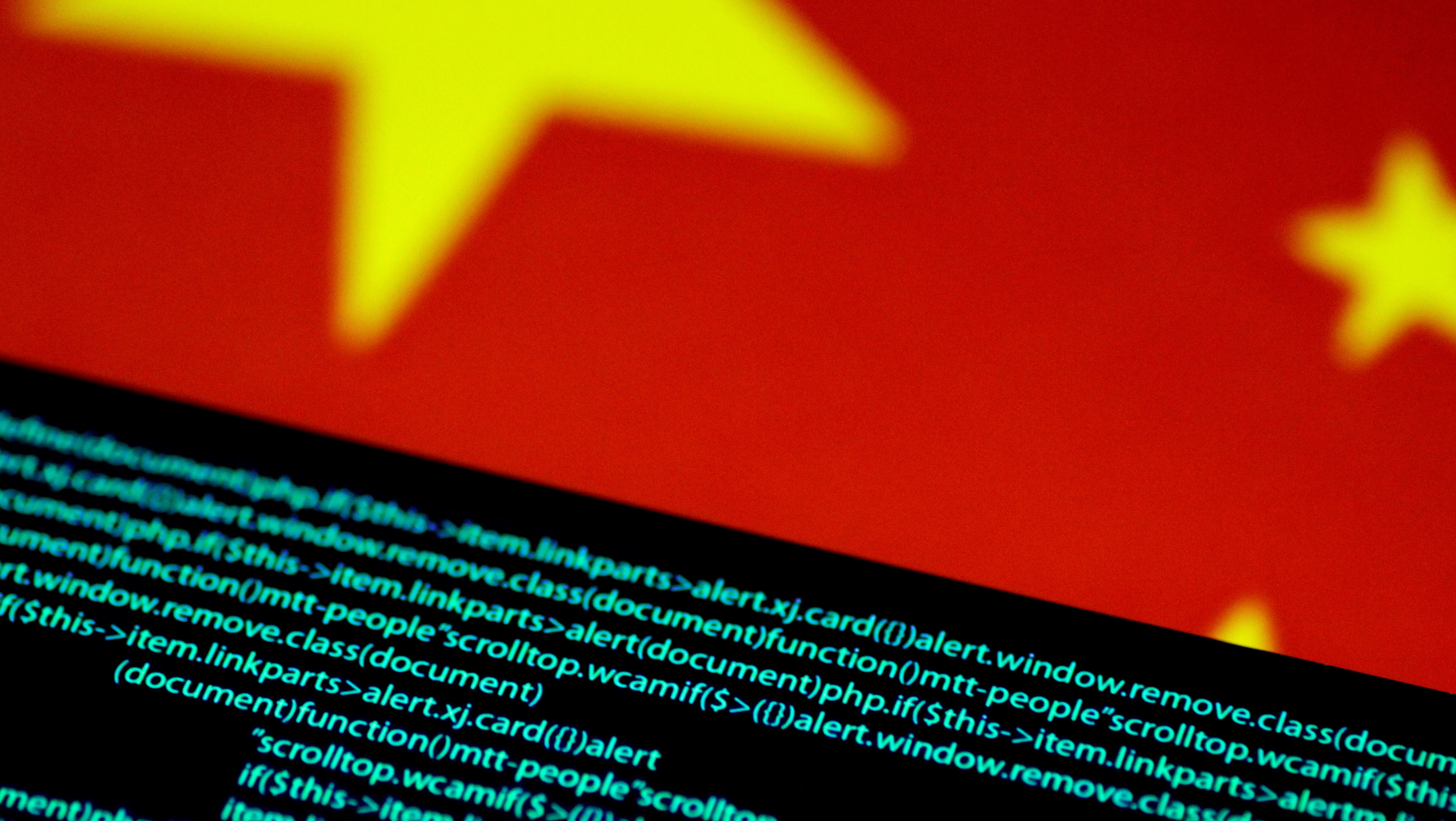 Computer code is seen on a screen above a Chinese flag in this July 12, 2017 illustration photo.   REUTERS/Thomas White/Illustration - RTX3B2TG
