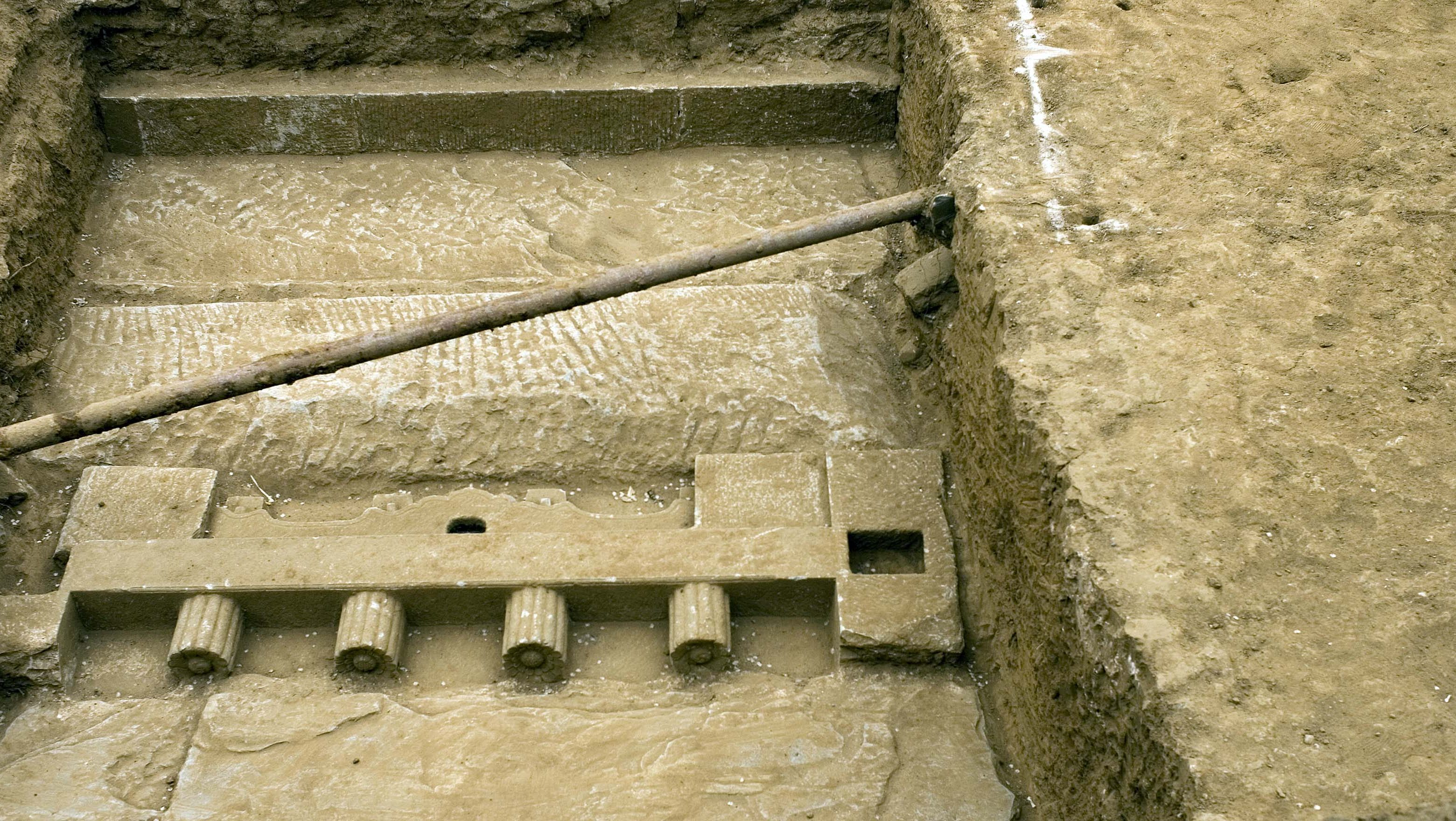 Relics seen in an open pit of suspected imperial-era tombs at the construction site of a shooting range for the 2008 Beijing Olympic Games where work has been suspended in Beijing, China, Monday, May 8, 2006. The tombs, found in mid-April, are believed to date back five to six centuries to the Ming dynasty and may be those of eunuchs serving at the imperial court, the Beijing Morning Post said. Beijing has been the site of imperial and other capitals for more than 1,000 years, and almost every major building project unearths gravesites or relics. Most are removed or destroyed before experts can examine them.