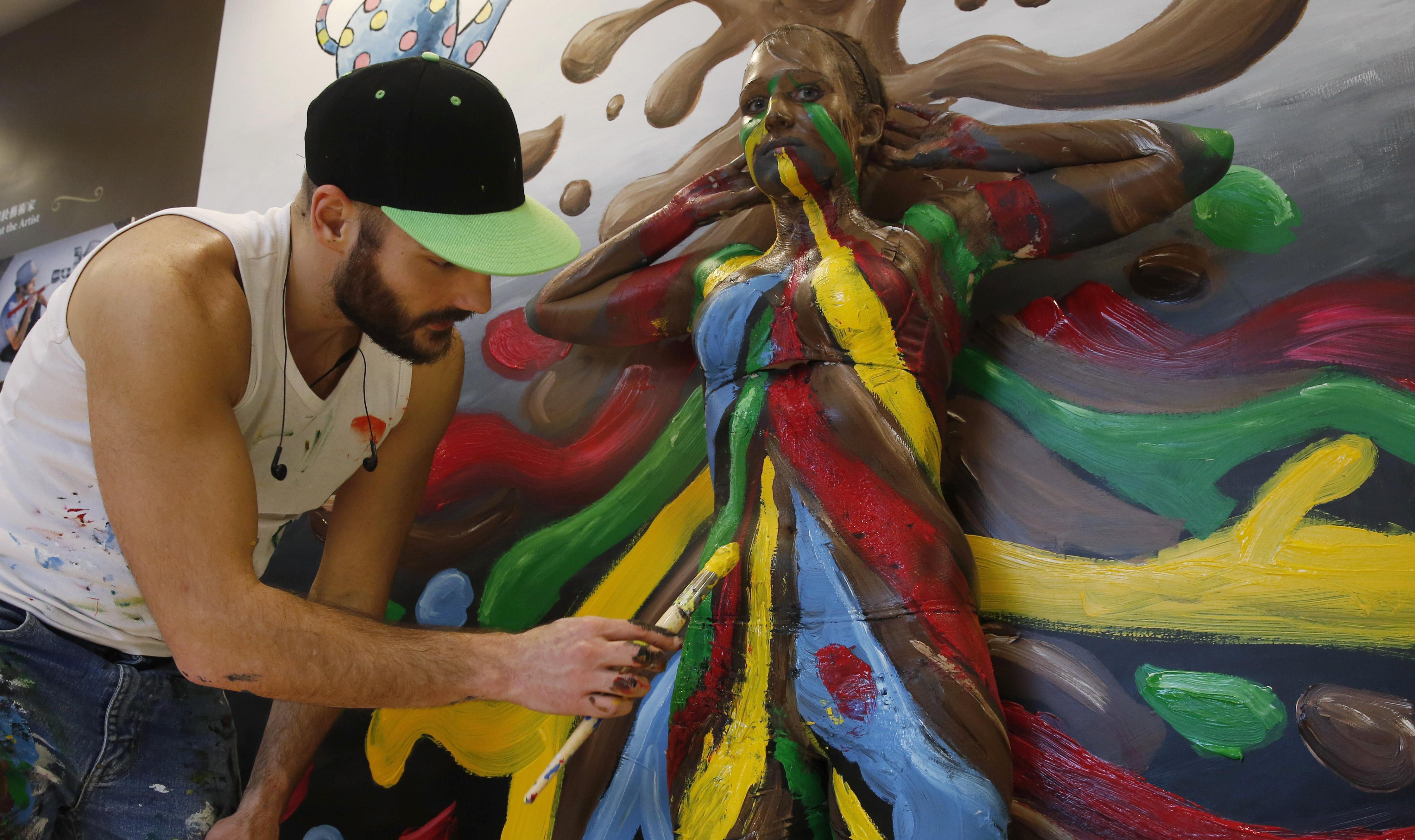 Man spray painting.